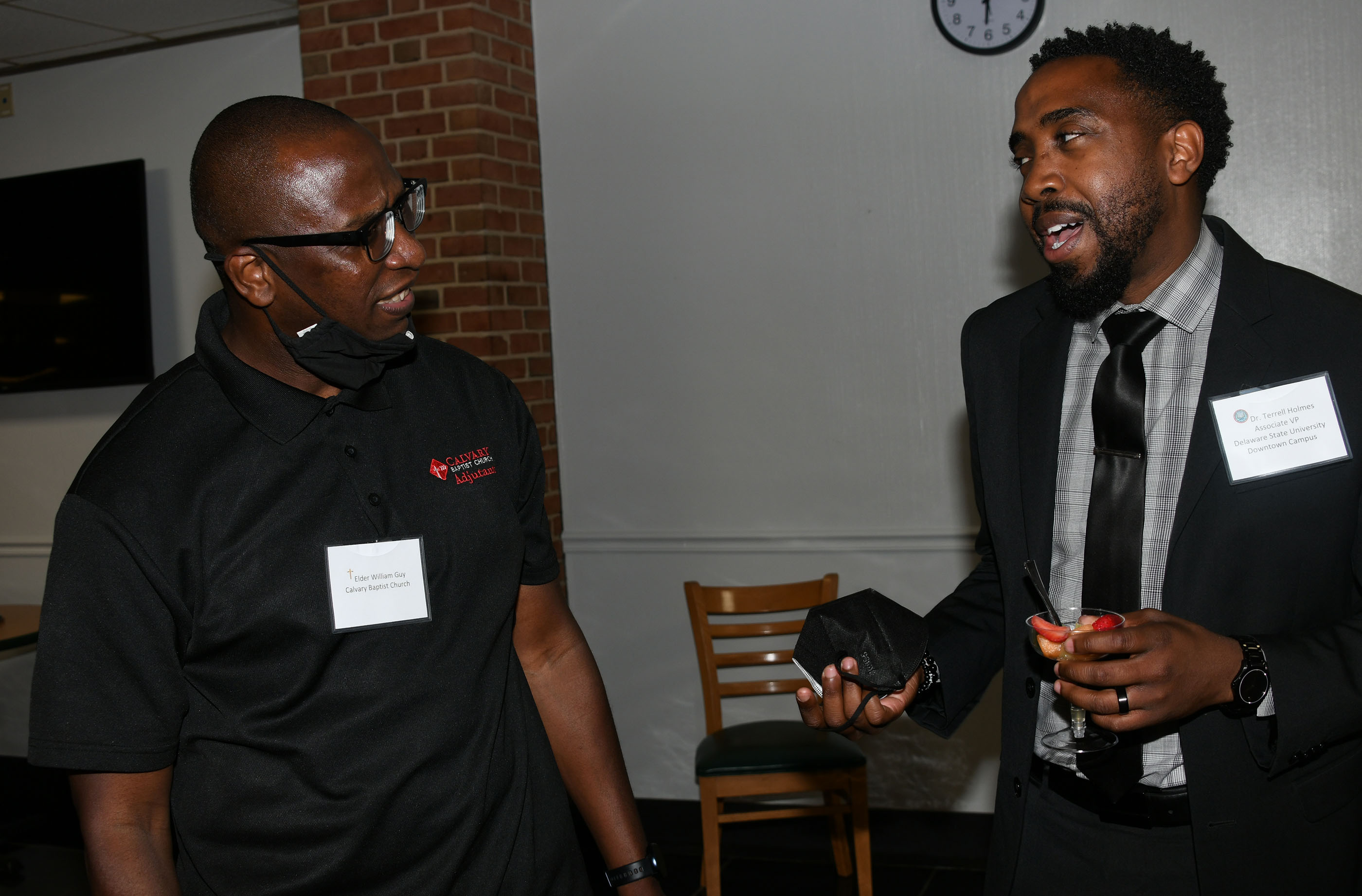 Elder William Guy of Calvary Baptist Church chats with Del State's Dr. Terrell Holmes