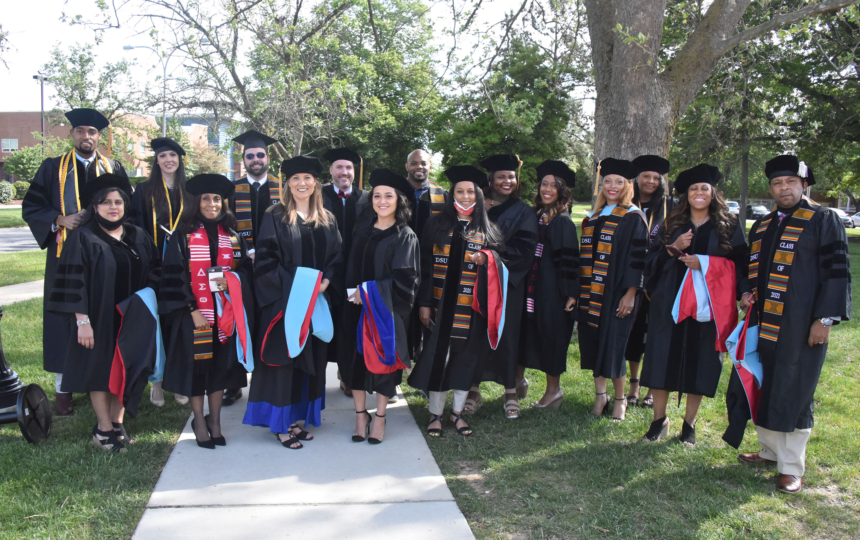Some of the doctoral graduates gather for a group shot before their May 7 Commencement.