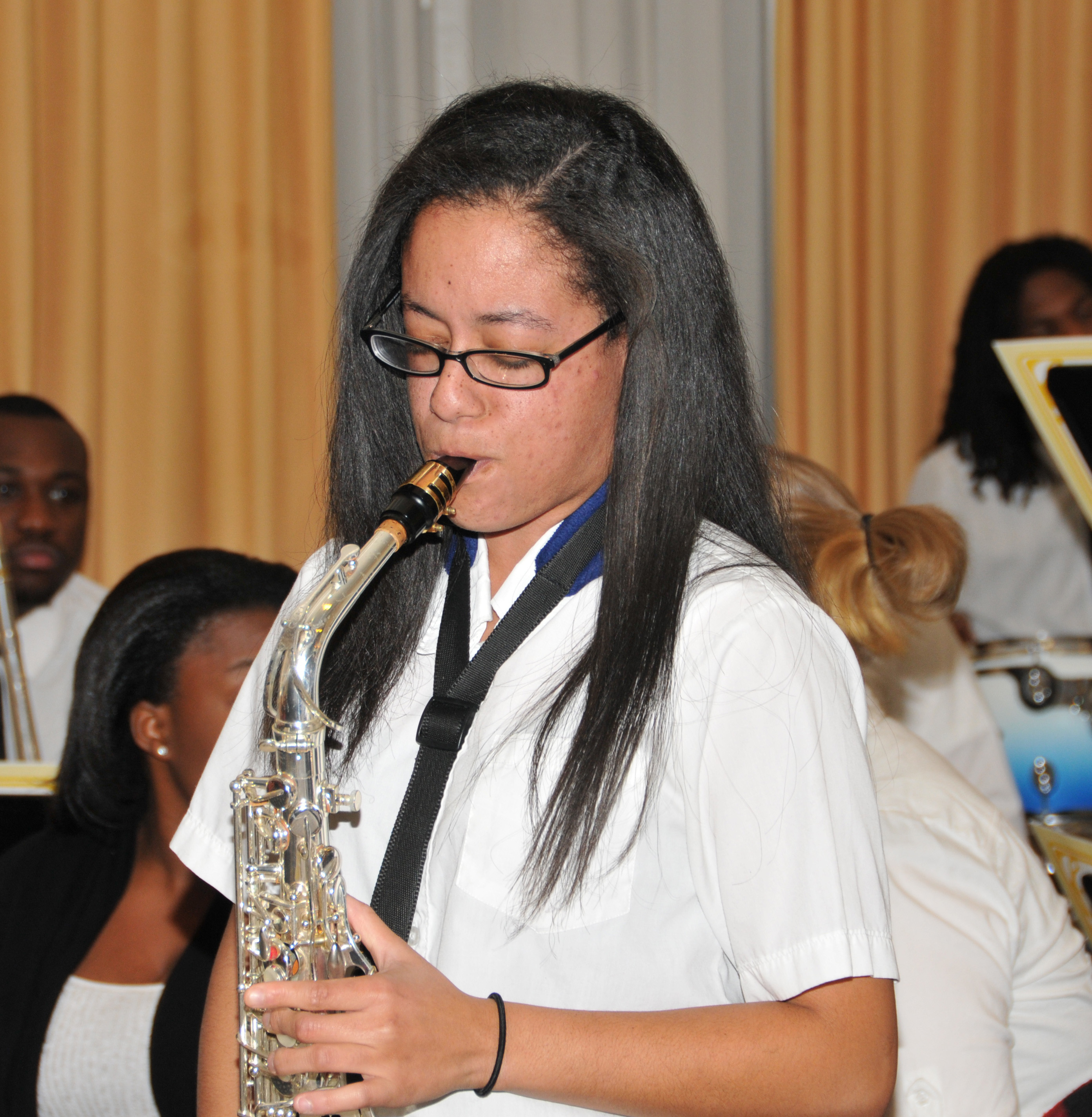 Ms. Williams, shown as a freshman in 2012 playing as sax solo with the Univ. Jazz Band. She plays nine instruments.
