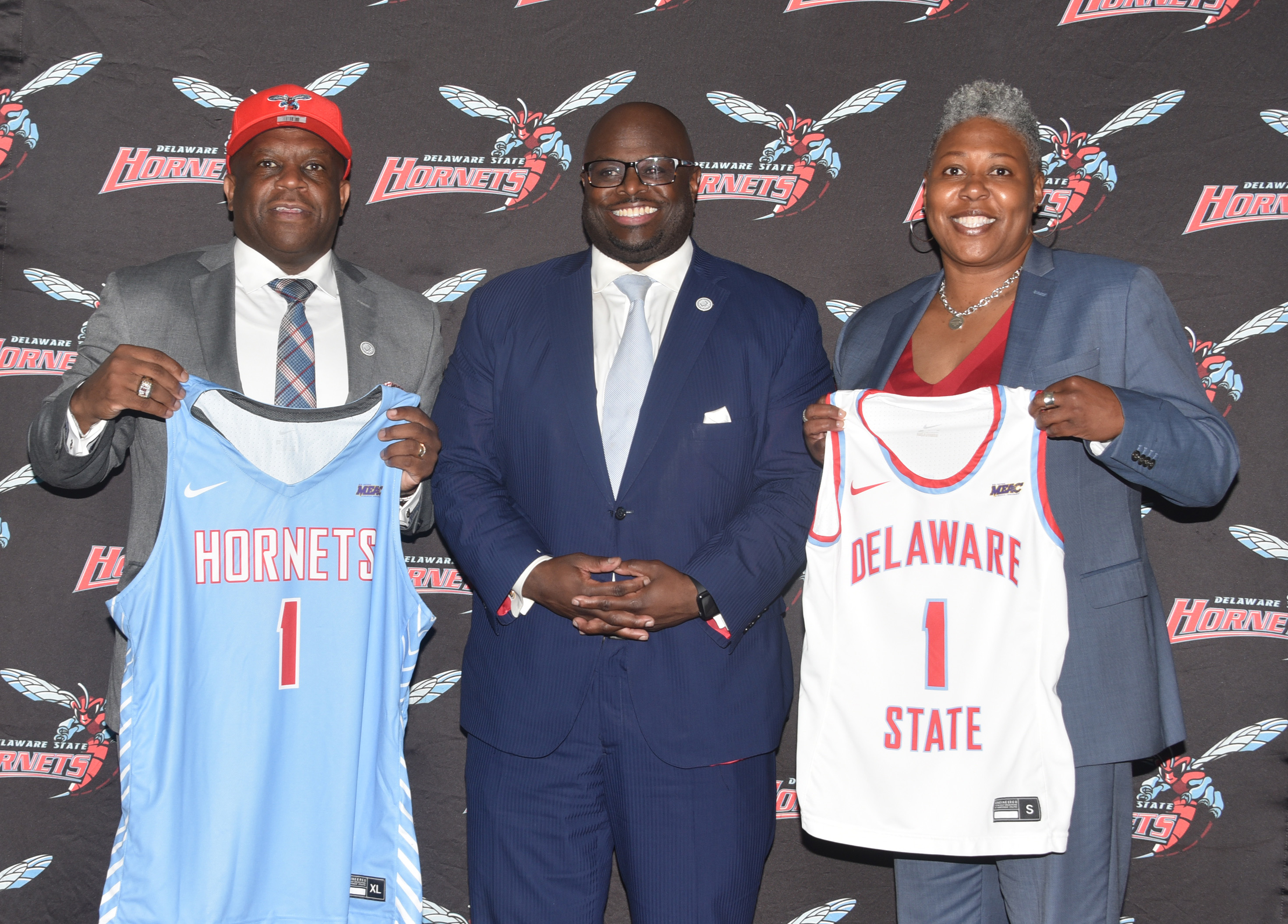 """University President Tony Allen (c), stands with new coaches Stan Waterman and Yconda """"EC"""" Hill."""