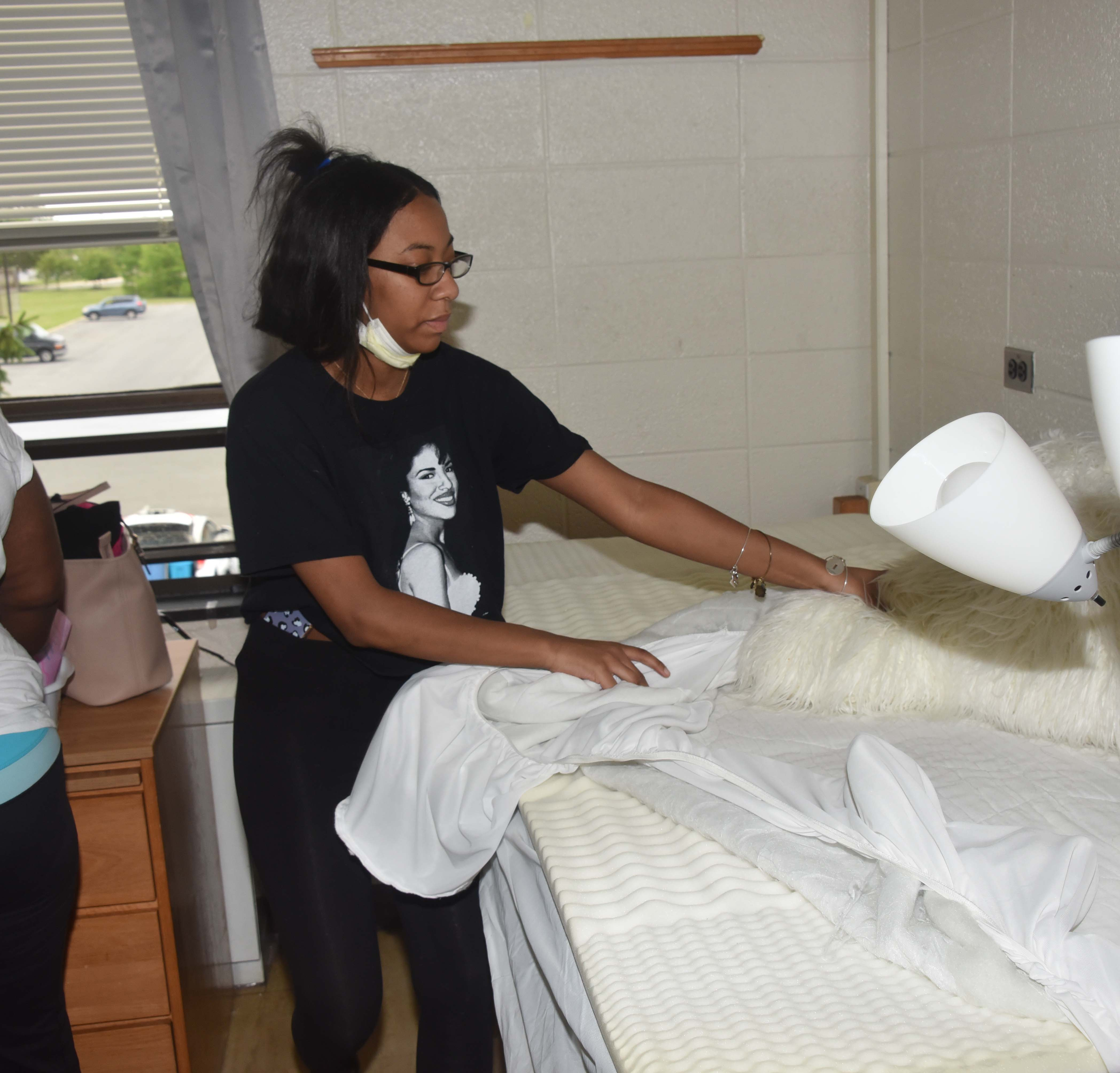 Kenisa Hawkes was not about to leave behind her personal bedding.