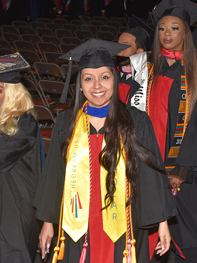Dulce Guerrero marches in with other graduates at the start of the Commencement Ceremony.