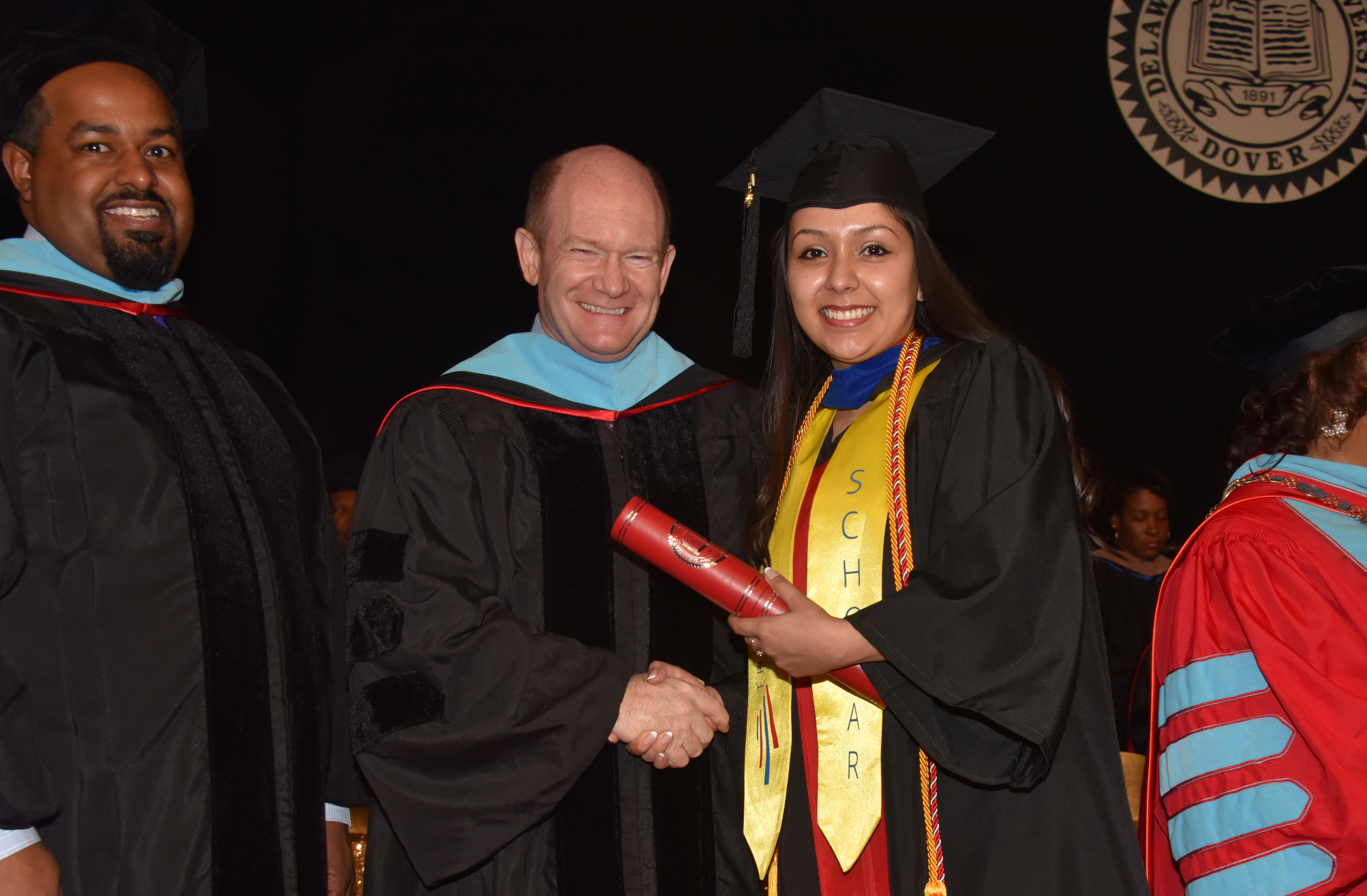 U.S. Sen. Chris Coons poses with Dulce Guerrero at the Dec. 14 Commencement Ceremony, where she became the first Opportunity Scholarship Dreamer to receive her bachelor's degree at Delaware State University.