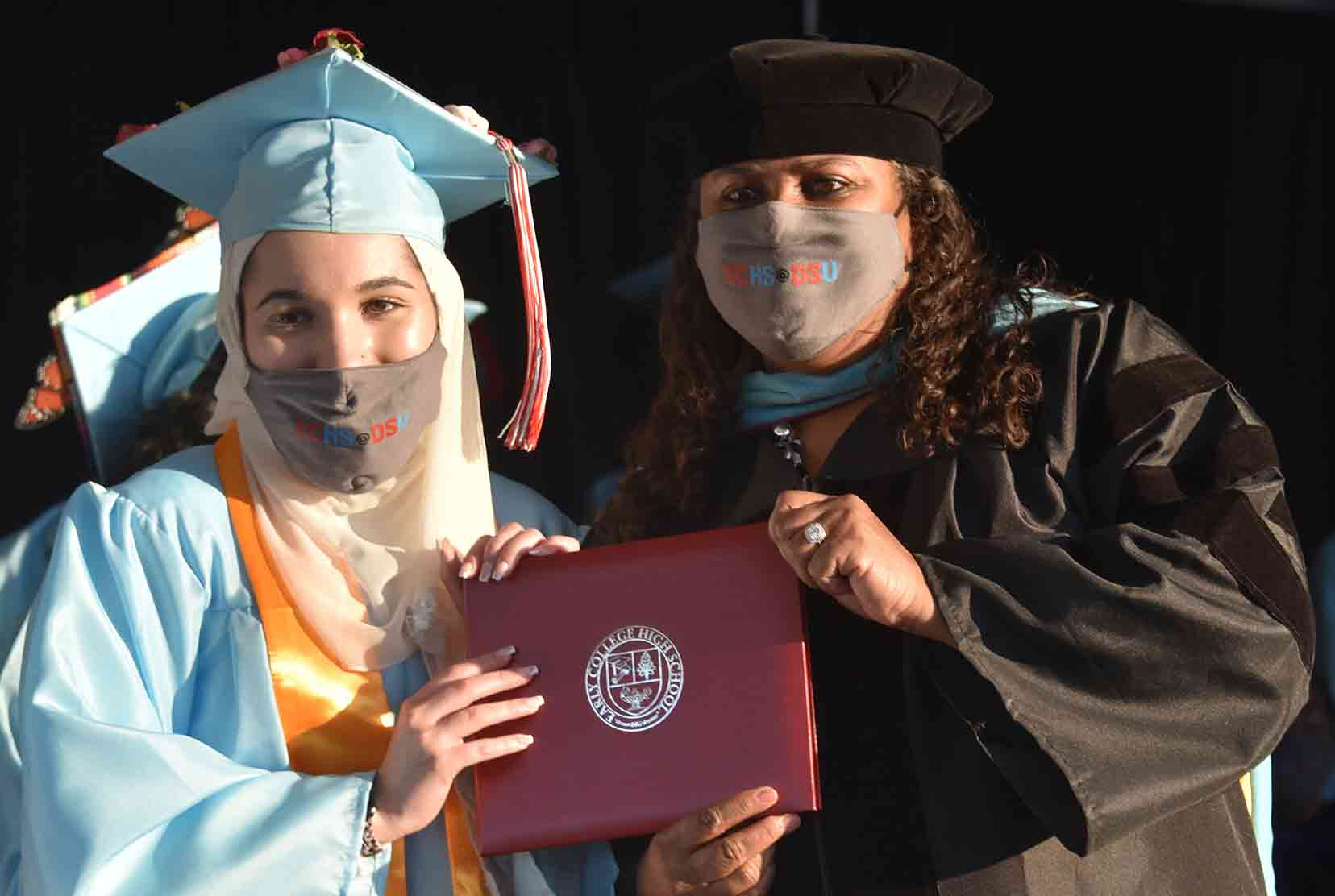 Zayna  Juracka (l), Early College High School Class of 2021 Valedictorian, poses with her diploma and ECHS Director Dr. Evelyn Edney