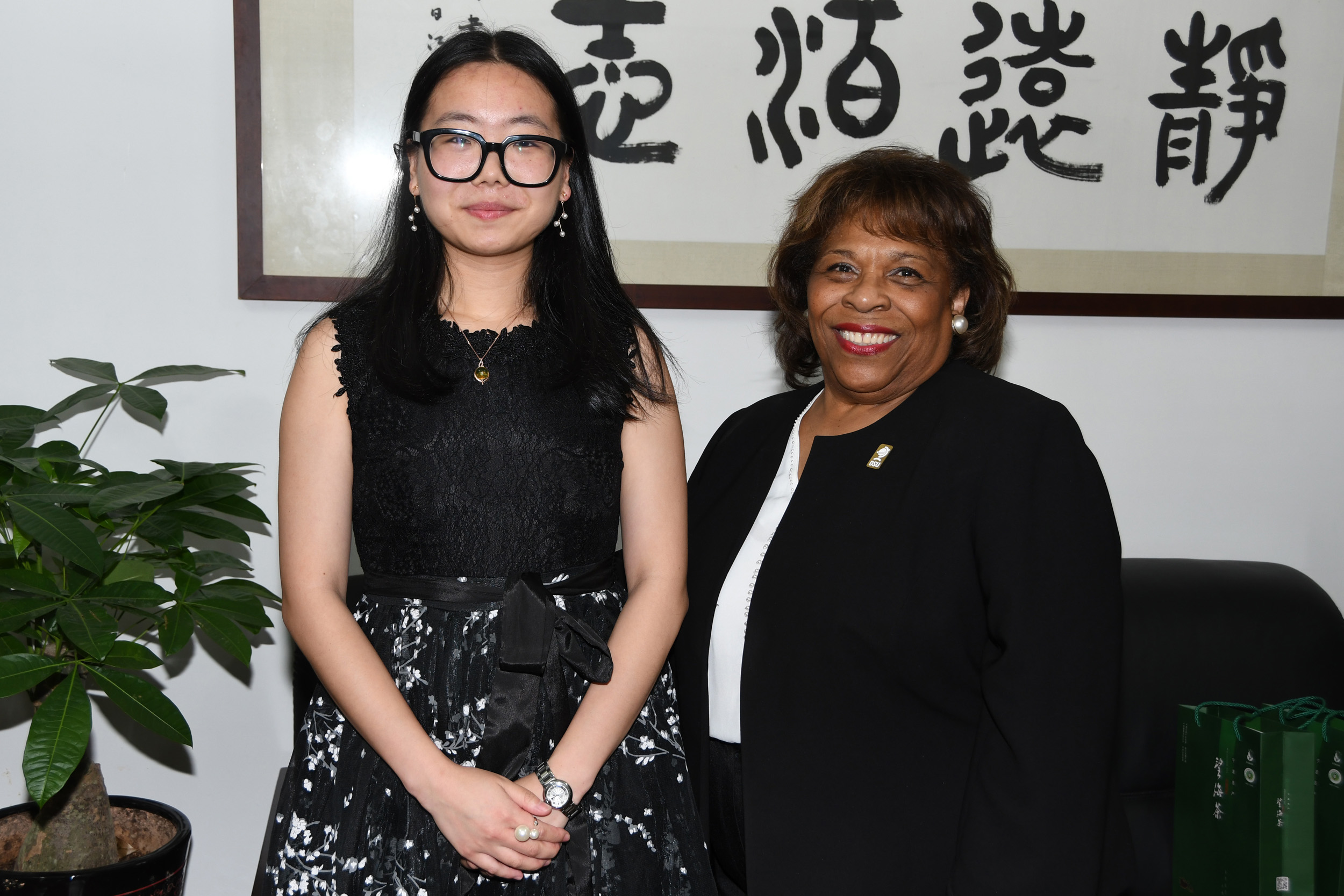 Dr. Wilma Mishoe poses with Chen Tong, a 2011 graduate of the joint Accounting Program. She is now an NBUT assistant professor.