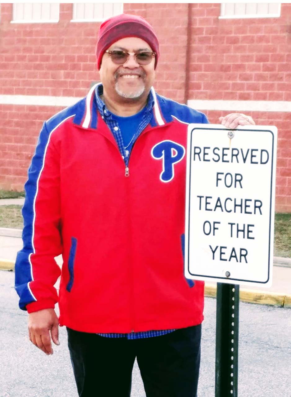 Milton Downing shows parking privileges come with Teacher of the Year honors.