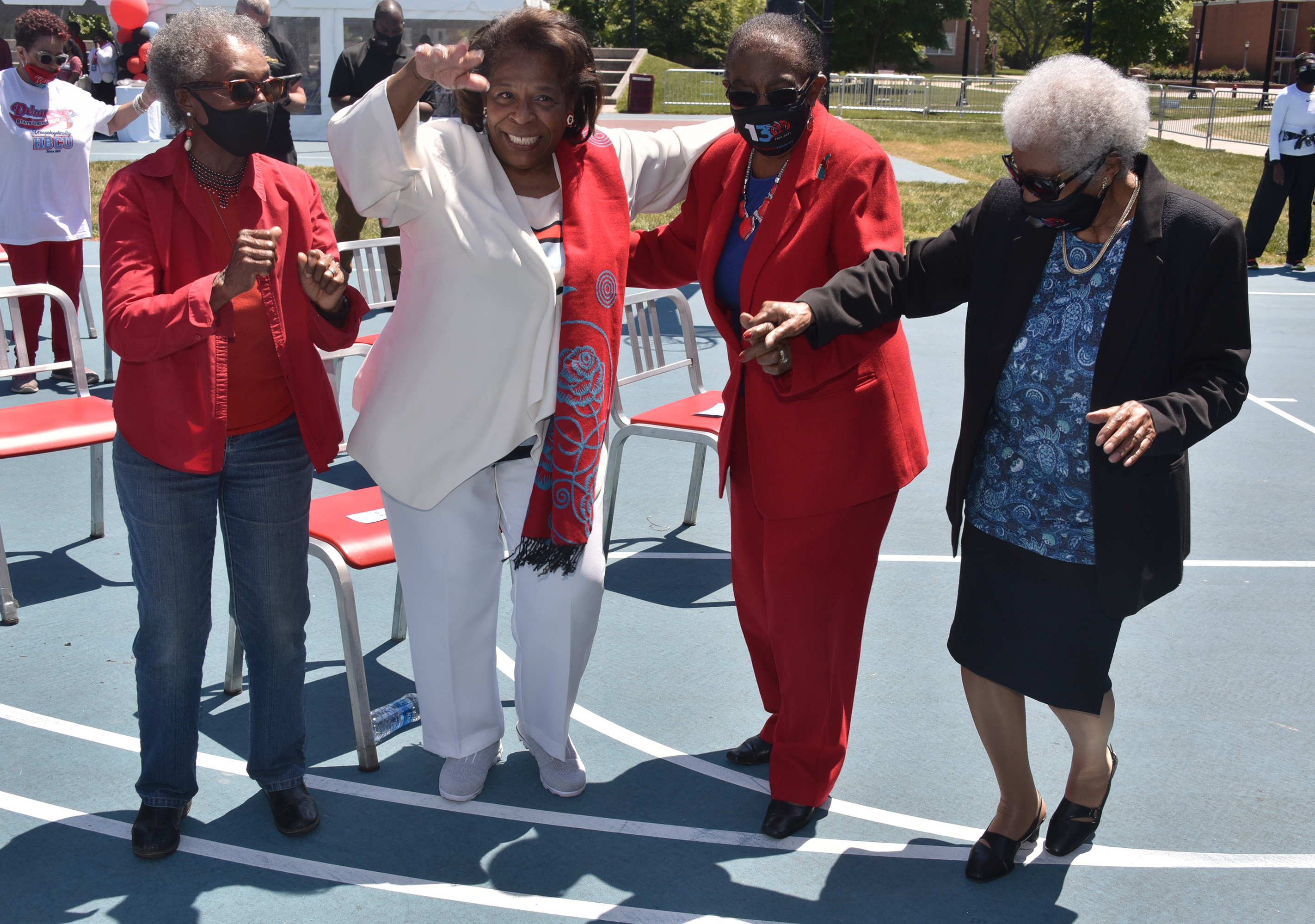 (L-r) Dolores Blakey, Dr. Wilma Mishoe, Dr. Reba Hollingsworth and Del State's oldest alum Susan Browne, 103, dance to the music