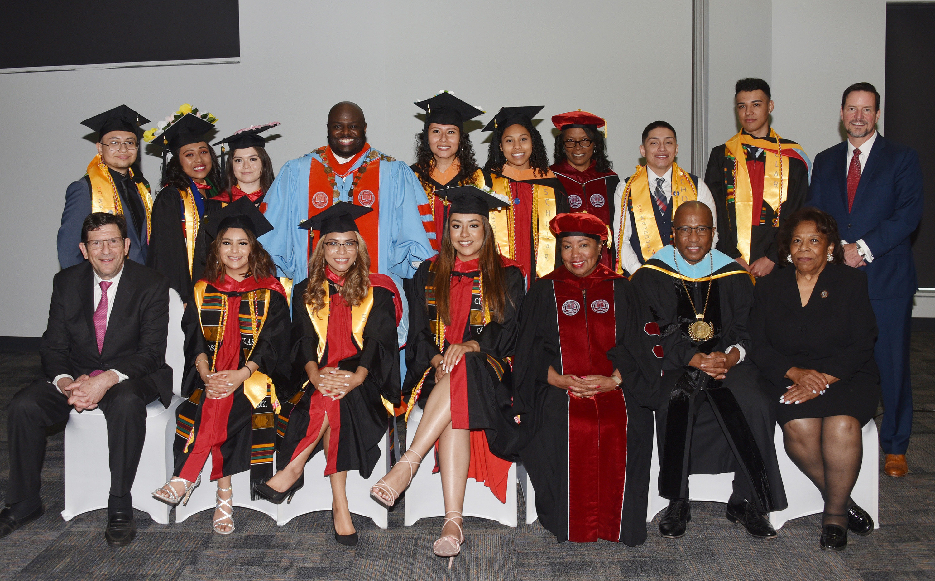 A group of graduating Dreamers pose with the DSU President and others.