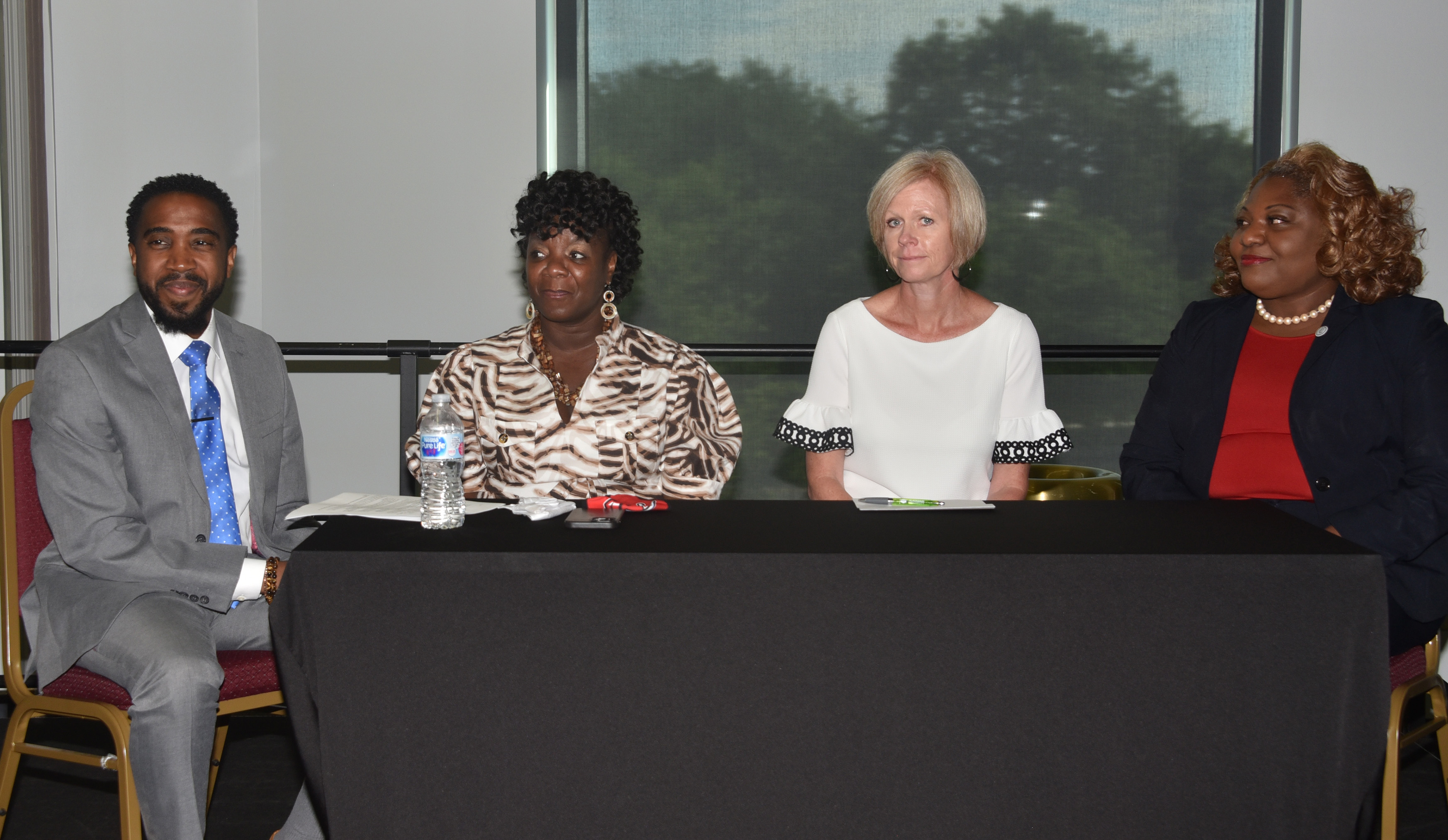 (l-r) Dr. Terrell Holmes, Dr. Stacy Downing, Laura Mayse, and Dr. Gwen Scott-Jones.