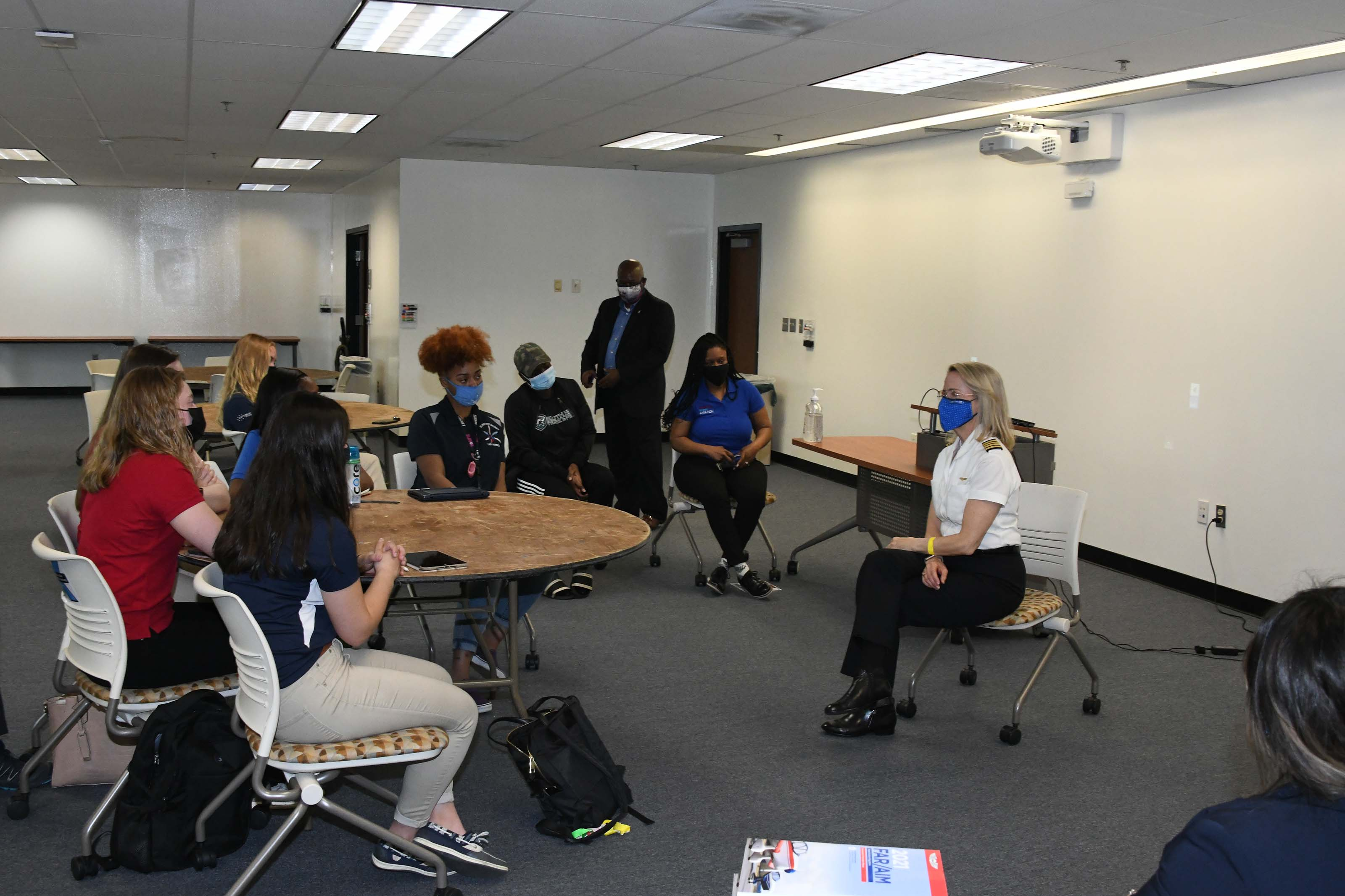 Chief Pilot Mary Ann Schaffer meets with female Aviation students.