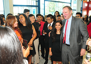 Donald Graham (r) stand with Dreamer Estephany Martinez during a 2017 visit to DSU.