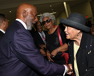 Prayer Breakfast keynote retired AME Bishop John Bryant talks with Betsy Williams.