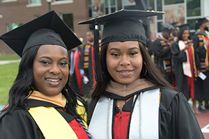 Sherreika Brown, who received a MSW degree, graduated with her daugher, who earned a BS degree in management.