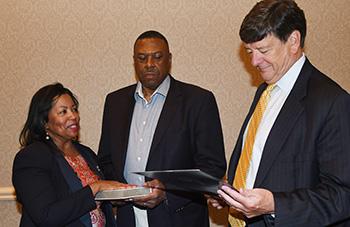 Dr. Devona Williams (l) is sworn in by General Counsel Tom Preston