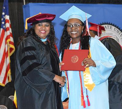 Esther Abiona, 2019 salutatorian, with ECHS Director Dr. Evelyn Edney.