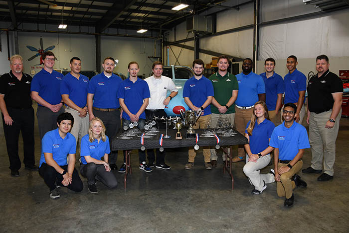 First-place Hornet Flight Team with alternates, coaches and awards.