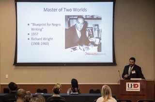 """Darrell Hughson presents his first-place paper on """"Odysses of the Black Scholar."""