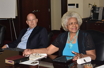 Participating in her first board meeting, new Trustee Esthelda Parker Selby sits next to Trustee Jack Markell.