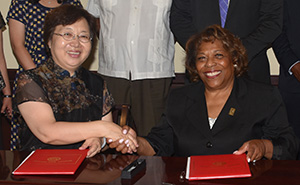Dr. He Ran of Changchun University shakes with Dr. Wilma Mishoe after signing an amended agreeement between the two schools.