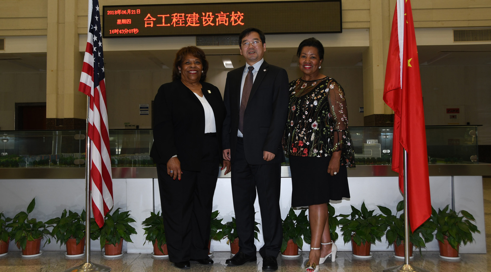 From left are DSU President Wilma Mishoe, NBUT President Lyn Zhongda and DSU Board of Trustees Chairperson Devona Williams.