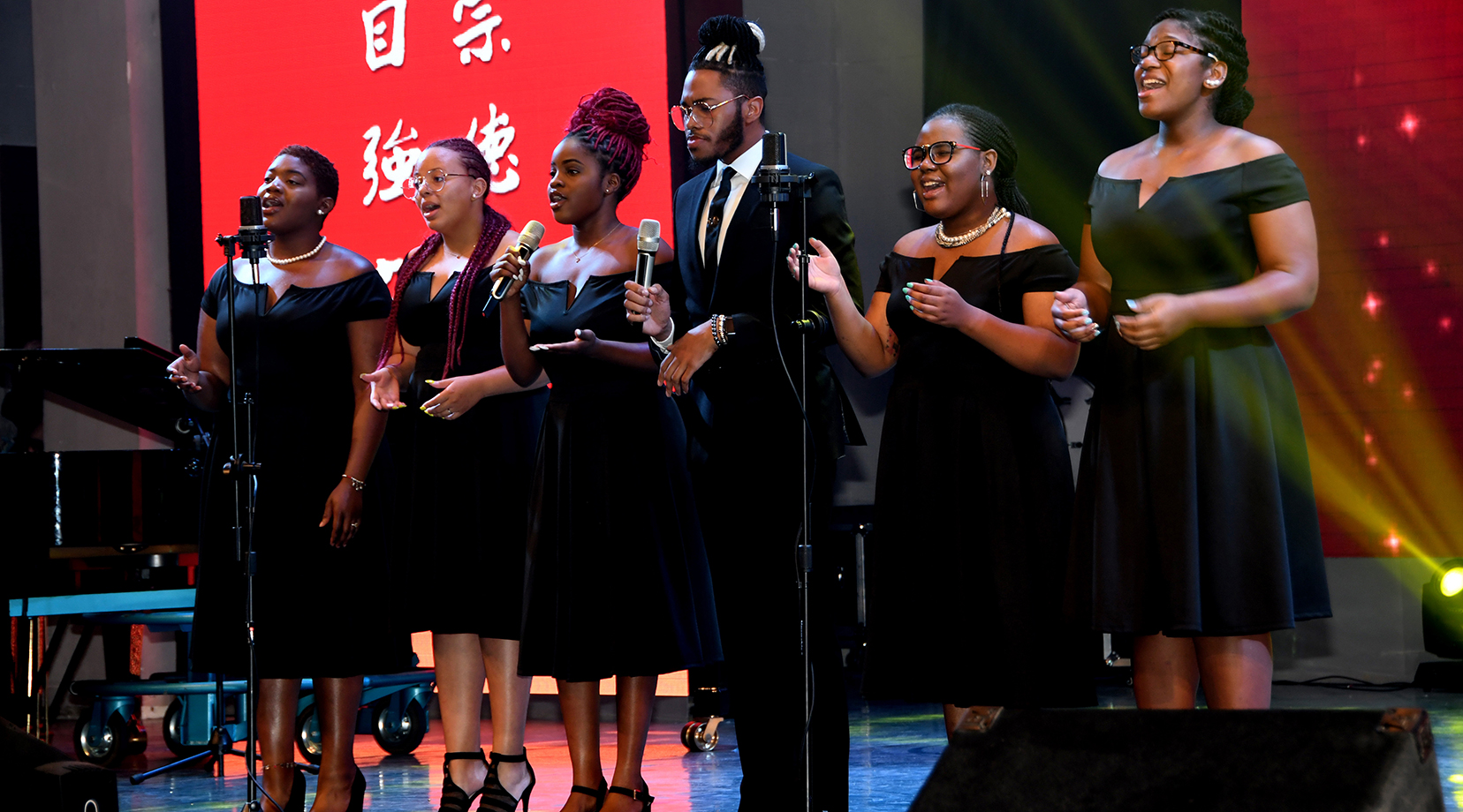 """DSU Gospel Choir members Kiyah Mewborn, Shaé Ross, Ashlyn Moore, Darrell Miller, Niraha Traylor and Jevana Lambert give a powerful performance of the song """"My God is an Awesome God."""" Not pictured are pianist Manuel Scott and drummer Nasir Carter Stokes."""