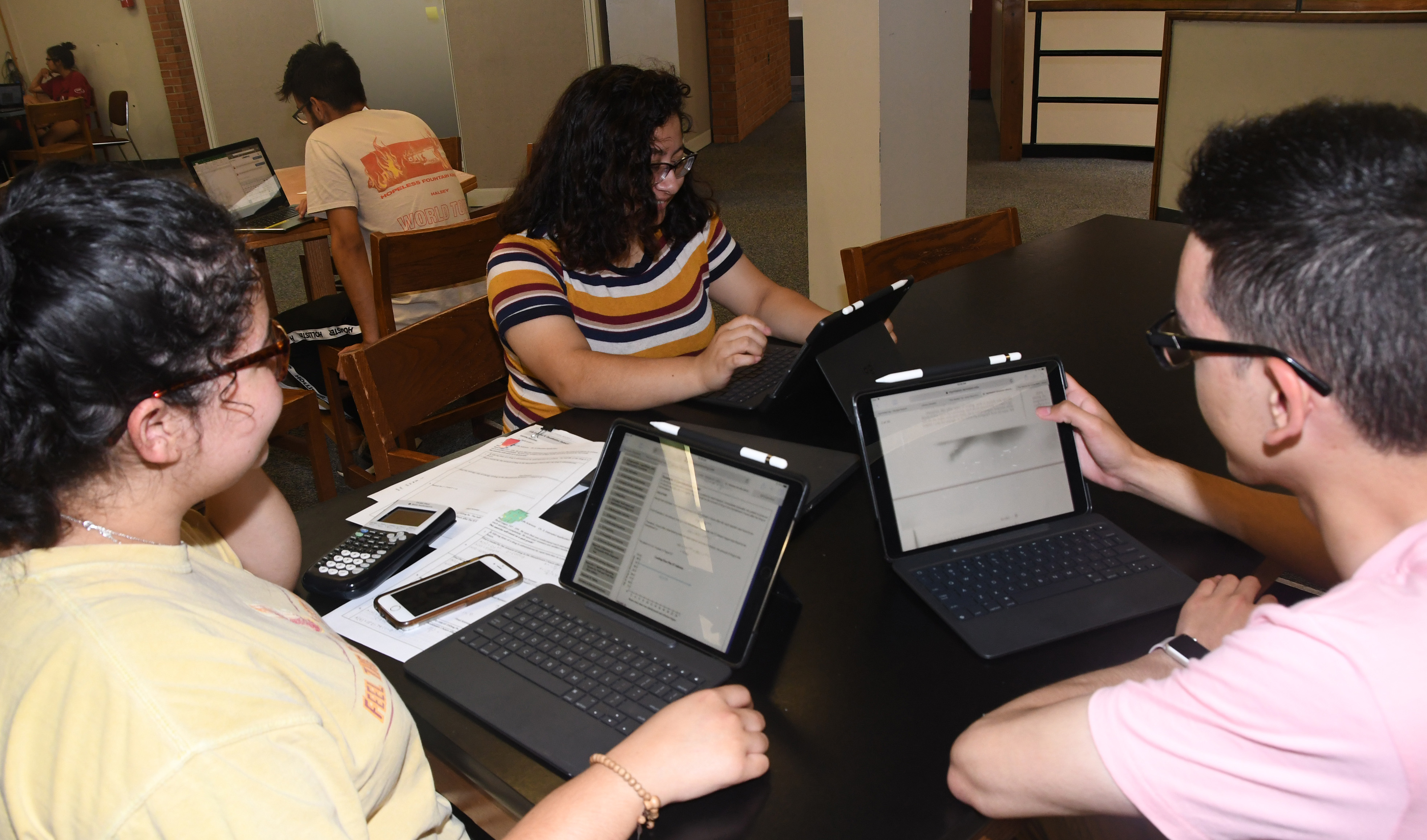 (lL-r) Freshmen students Karine Hernandez, Estefany Bonilla and Filiberto Camarillo have easily incorporated their new Apple iPad Pros into their study sessions.