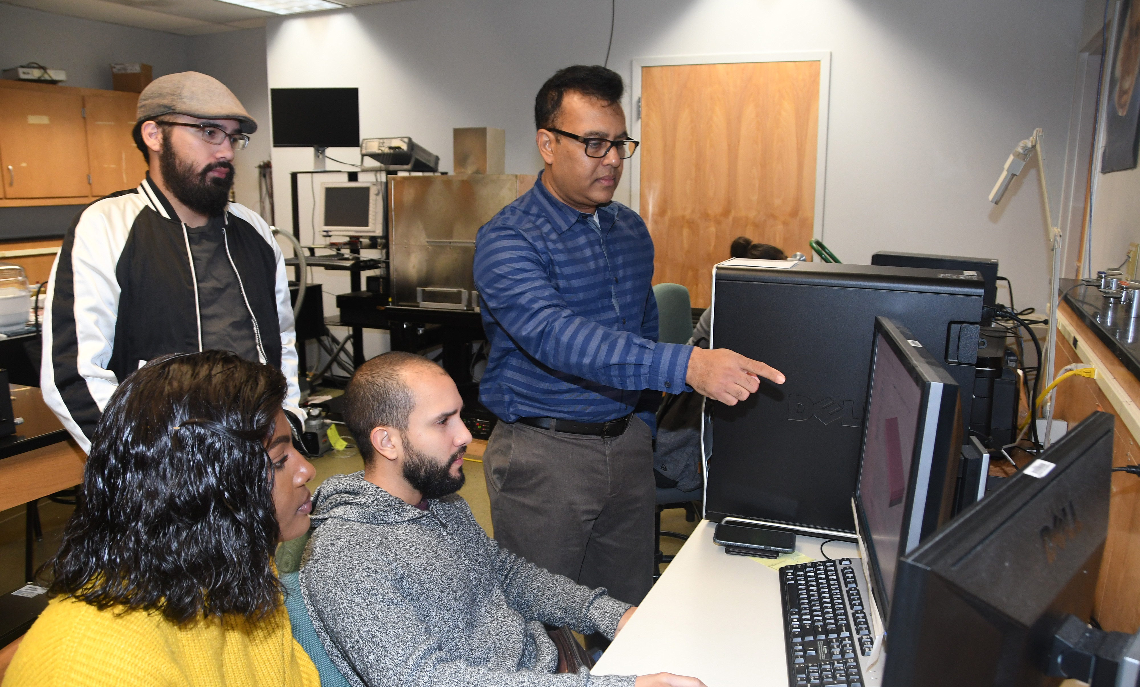 Dr. Mukti Rana (r), principal investigator of the grant, will provide these students -- (l-r) Larine Mbabit, Jaime Cardona and Kevin Diaz -- and others some hands-on research experience through this project.