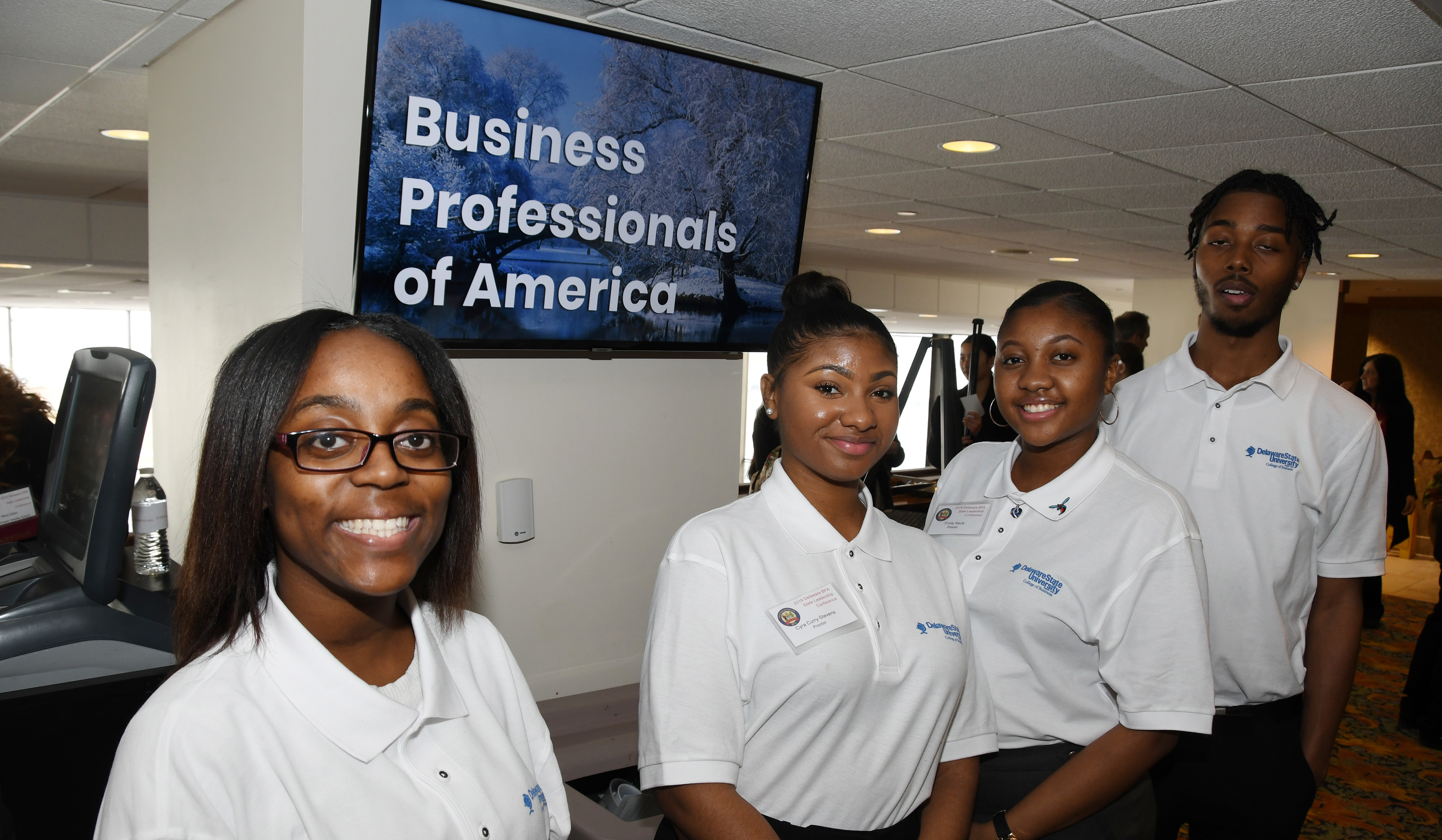 (L-r) University students Charlyeshia Jones, Trinity Savis, Tyra Curry-Stevens and Marvin Hagwood were among the 90 Delaware State University students who volunteered as proctors for the Delaware Business Professionals of America Leadership Conference held at Dover Downs Hotel and Casino Feb. 26-27.