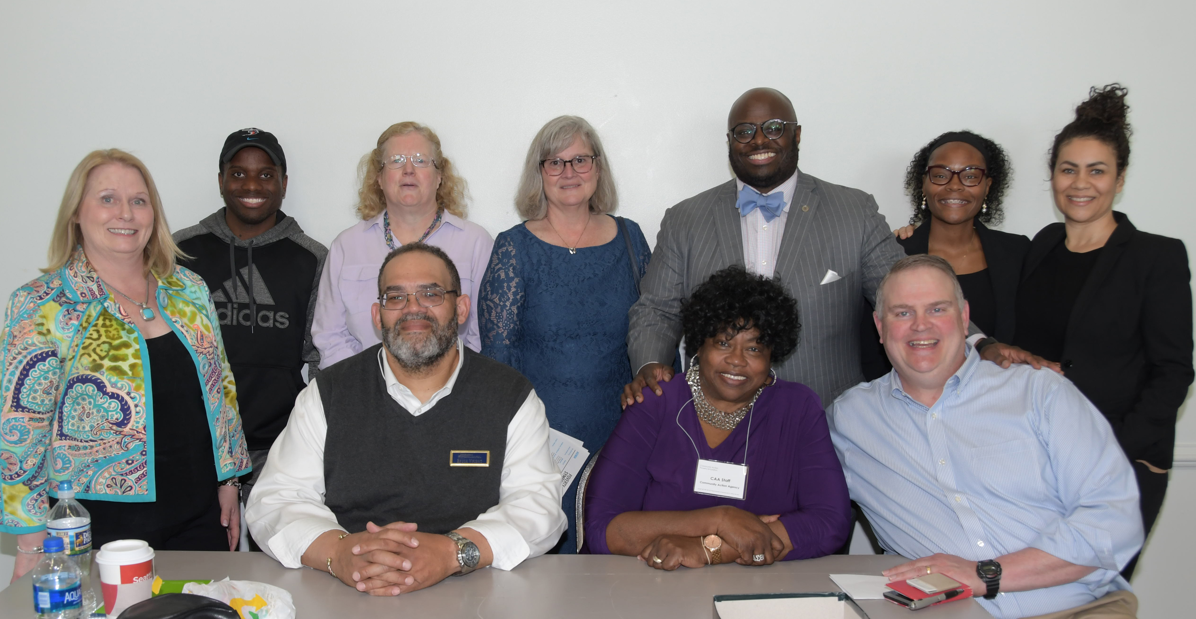Poverty Symposium leaders: (seated l-r) Bruce Wright and Bernice Edwards of First State Community Action, state Sen. Colin Bonini; (standing l-r) Cynthia Pritchard of Philanthropy Delaware, University student Rex Haye, University Social Work Dept. chair Dr. Kelly Ward, University Psychology Dept. chair Dr. Dorothy Dillard, Provost Tony Allen, keynote speaker Lillian Singh and Kat Goughnour, both of Prosperity Now.