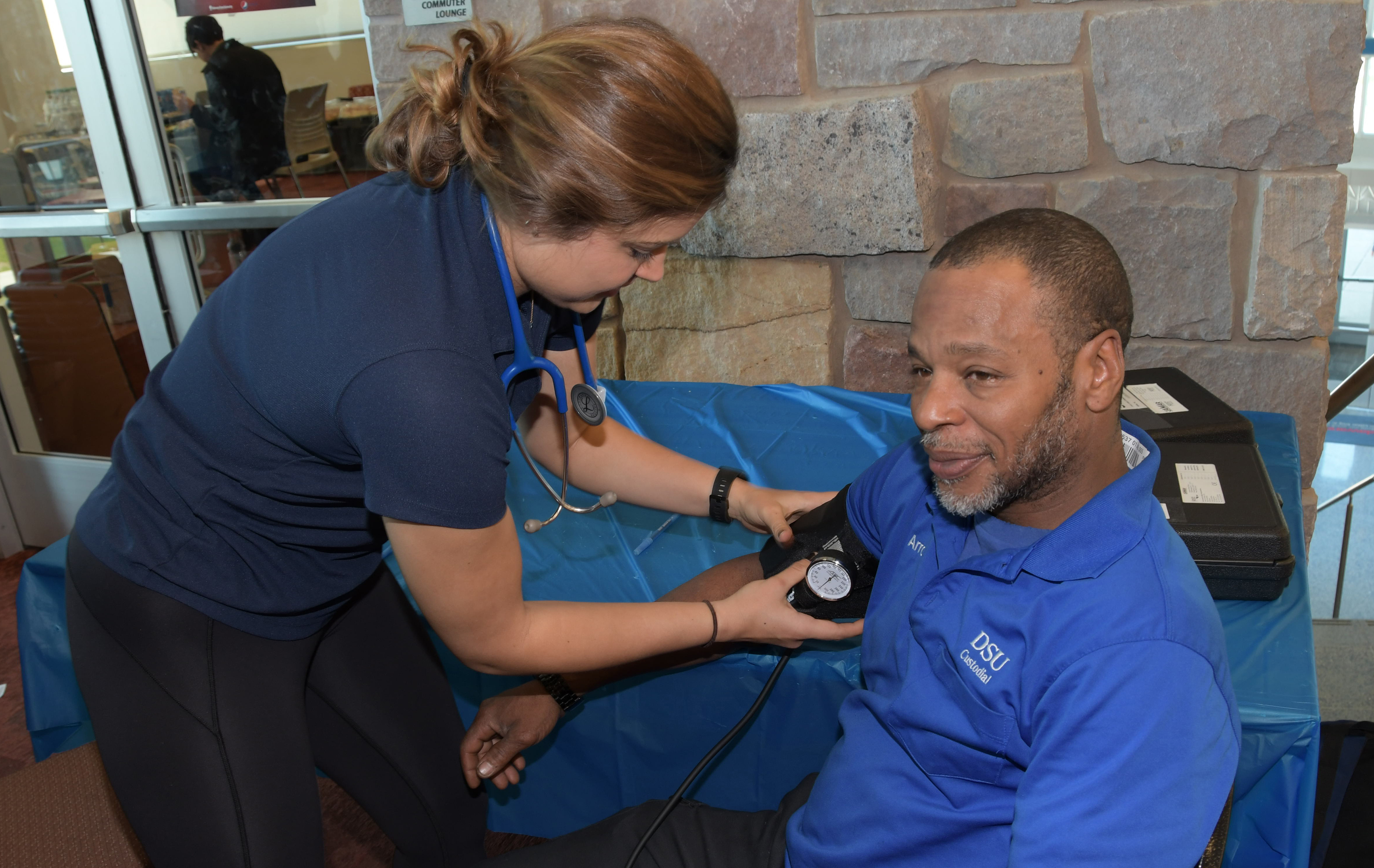 One of DSU valued custodian Arron Brown takes a break to get his blood pressure check during the activities at the Public Health and Fitness Leaders' Day in the MLK Jr. Student Center.