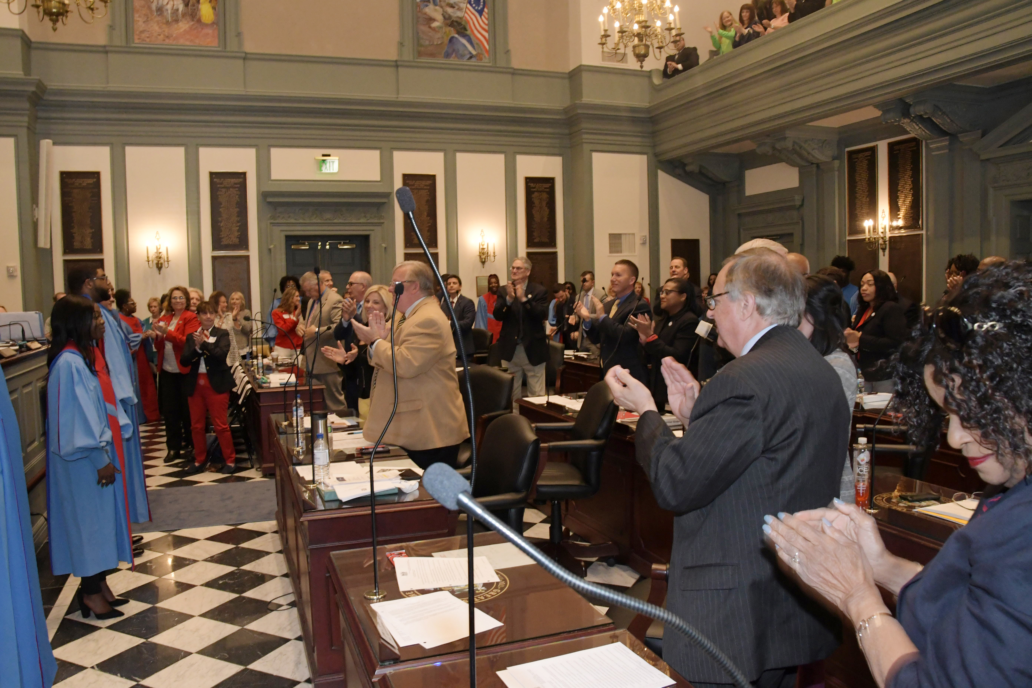 The University's Concert Choir receives a standing ovation from the House of Representatives following an April 17 performance.