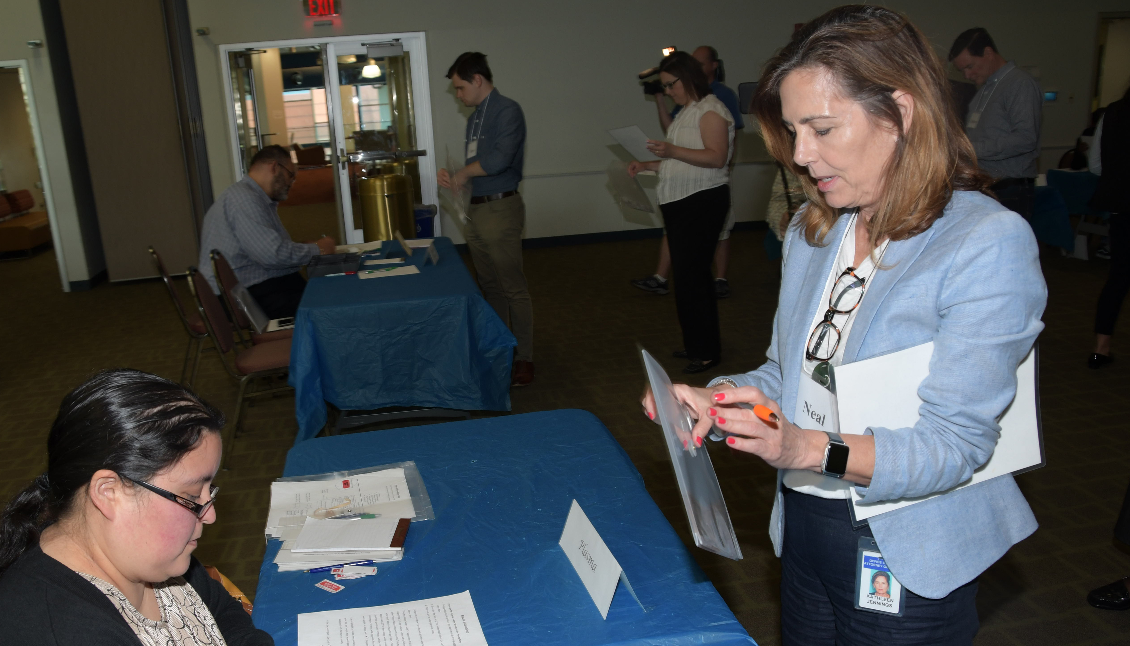 State Attorney General Kathleen Jennings attempts to sell her plasma during the Re-entry Simulation held at Delaware State University.