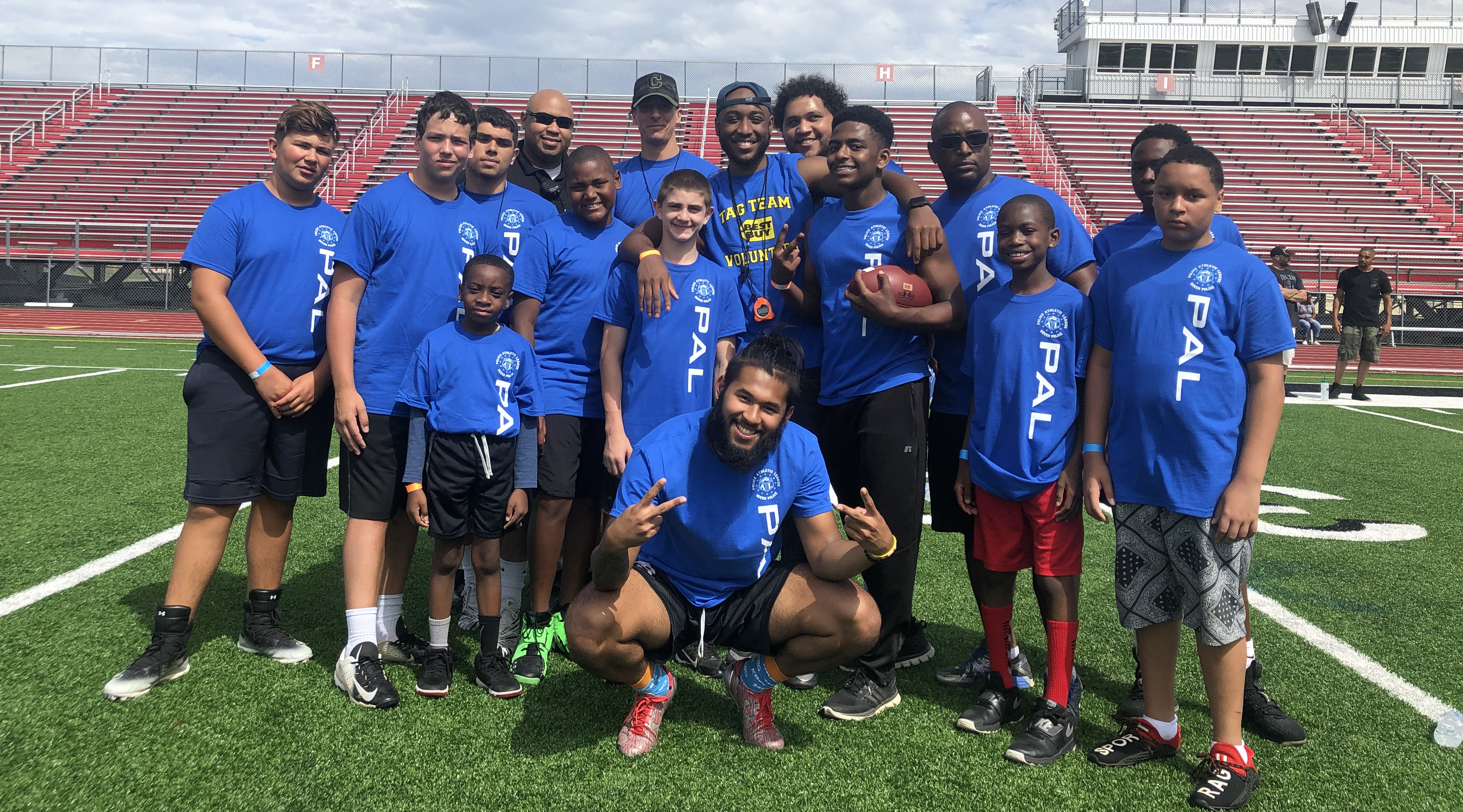 Police officers from Delaware State University and the Dover Police Athletic League came together for the 2nd Annual Youth Football Combine held at Alumni Stadium.