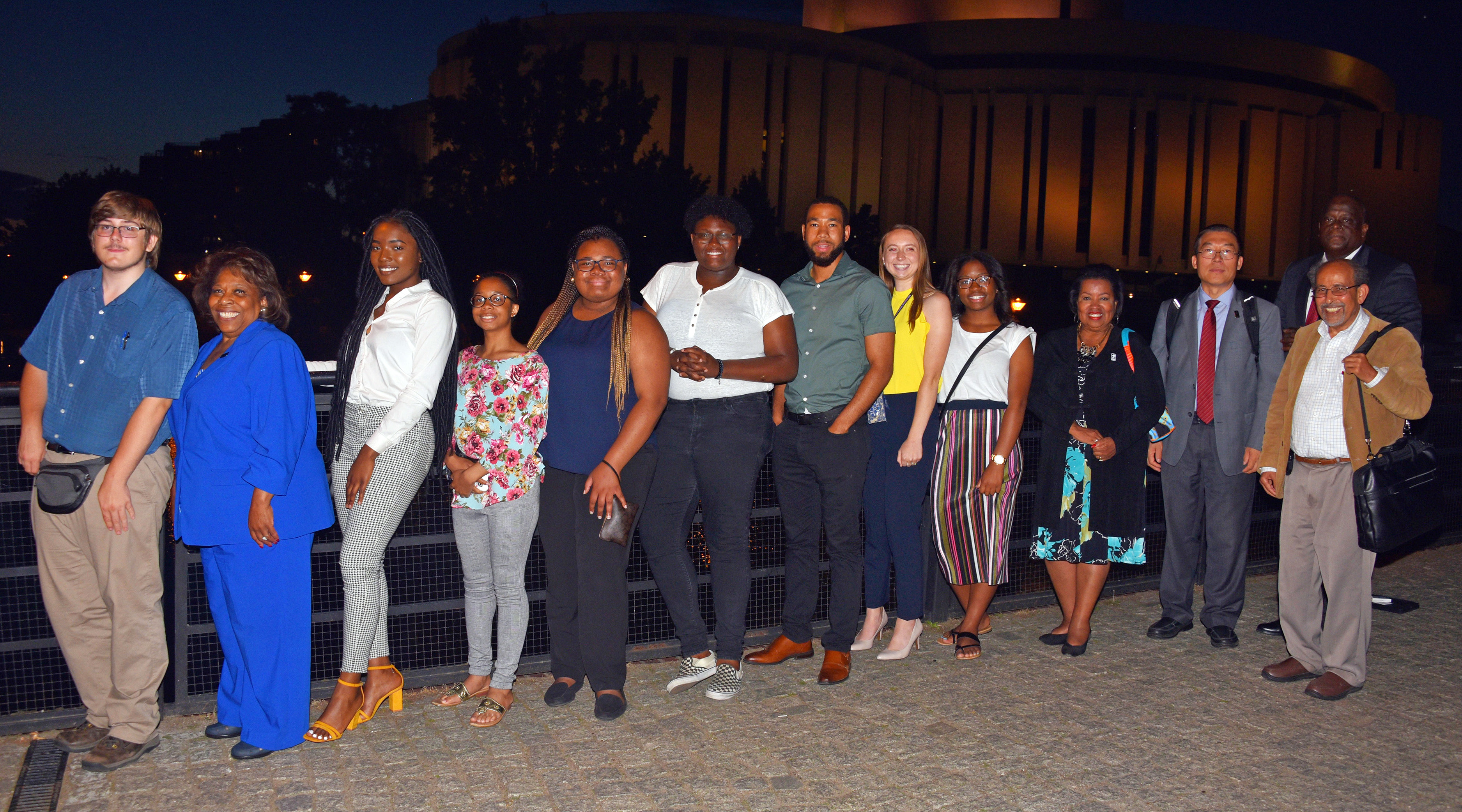 After dinner photo: (l-r) Dominic Morrell, University President Wilma Mishoe, Juliana Paul, Mykia Toney, Destiny King, Kishaye Williams, Corban Weatherspoon, Pamela Schork, Jacori Small, Board of Trustees Chairperson Devona Williams, along with Dr. Fengshan Liu, associate VP of International Affairs, Dr. Mazen Shahin, AMP Director, and Tony Boyle, VP of Strategic Enrollment Management.
