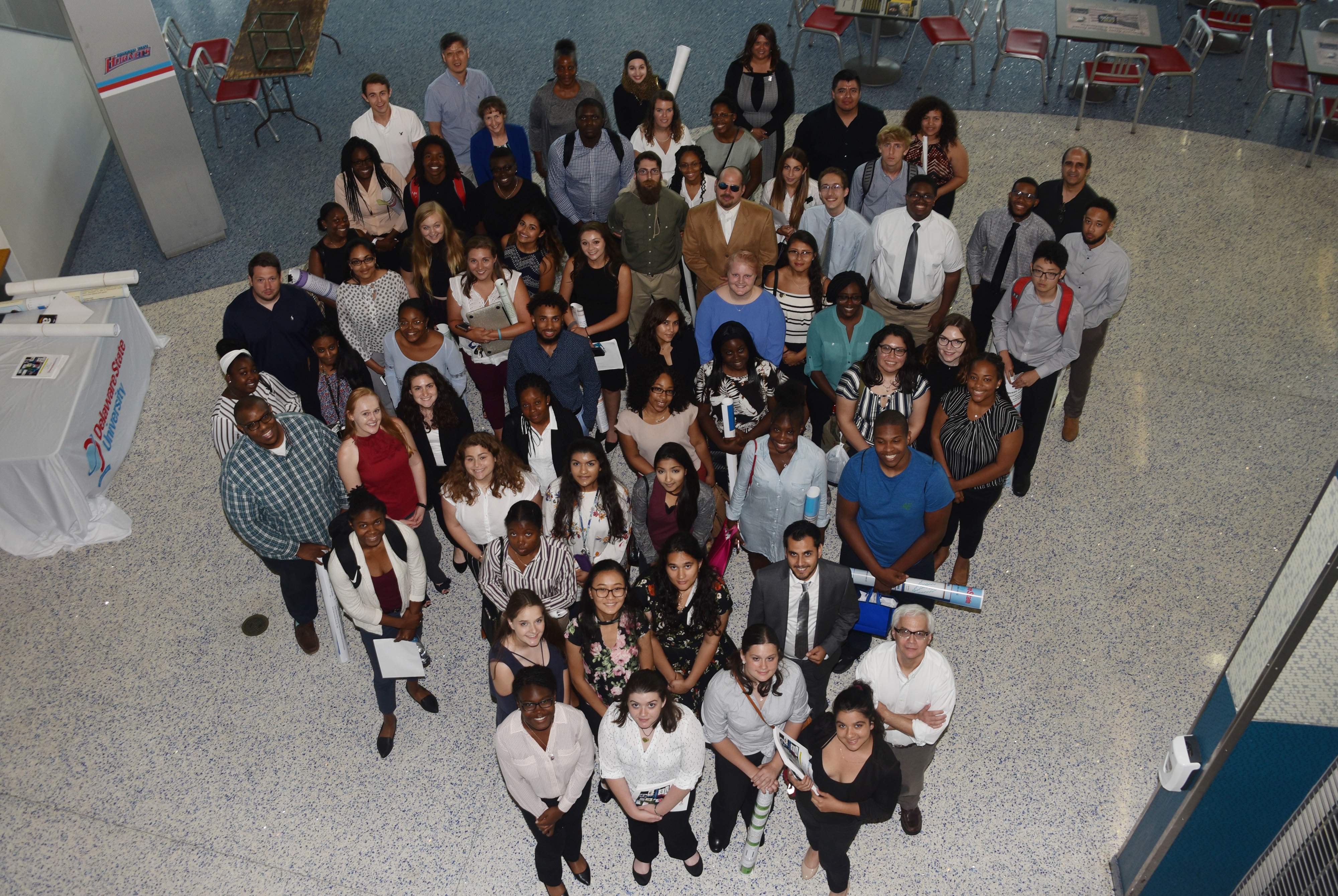 The 2019 Summer Research Symposium participants pose for a group shot at the end of the July 26 event.