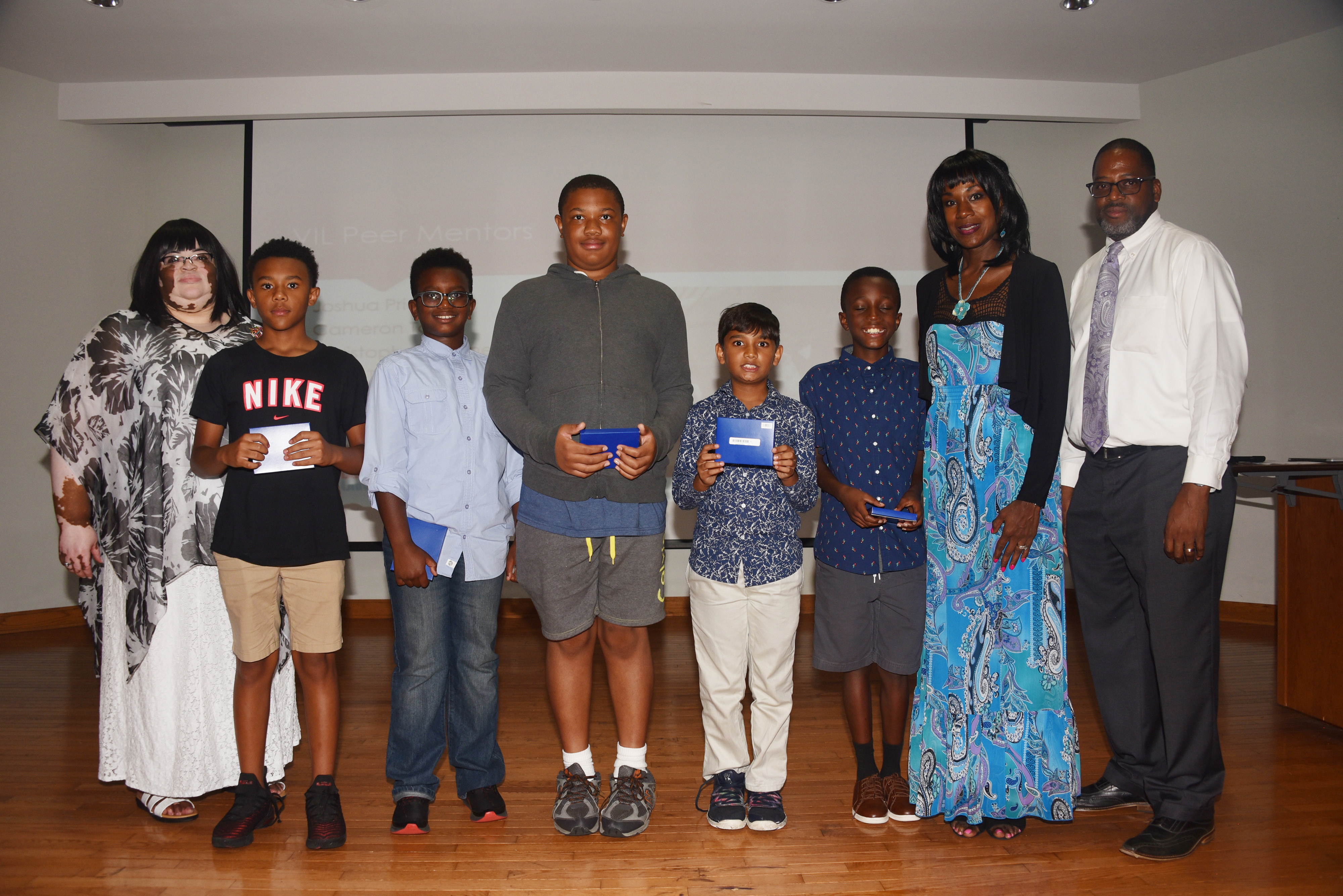 The Verizon Summer Camp's 1st place team -- The Thinkers. (L-r Dr. Charity Shockley, camp director; Thinker team members Xavier Gordy, Christian Auguste, Tristan Cooper, Vraj Shah and Kinte Tolson; and camp co-directors Lillie Crawford and Vaughn Hopkins.