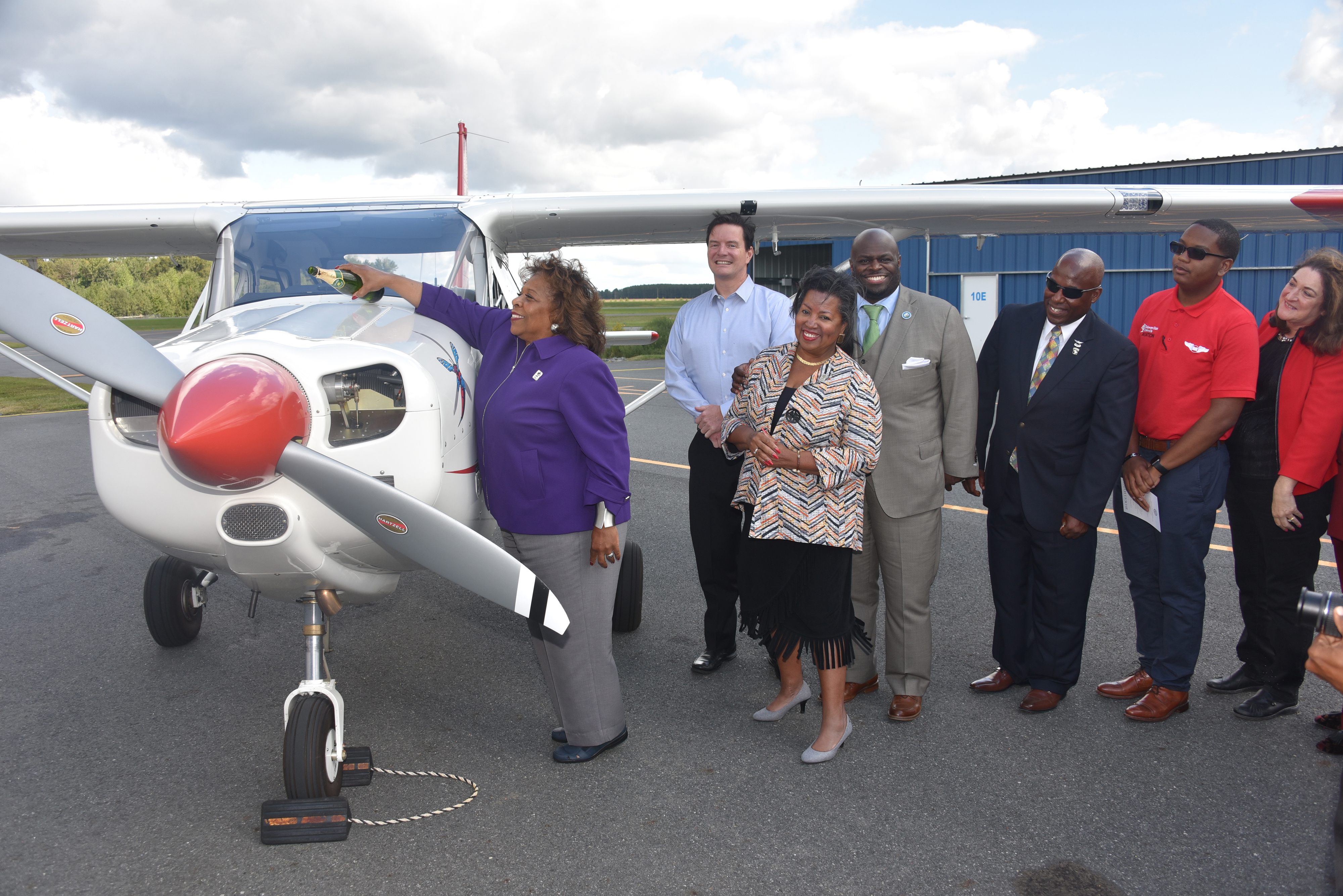 University President Wilma Mishoe christens the Aviation Program's newest aircraft, which is the first of a new 11-plane fleet that is slated to be delivered soon.