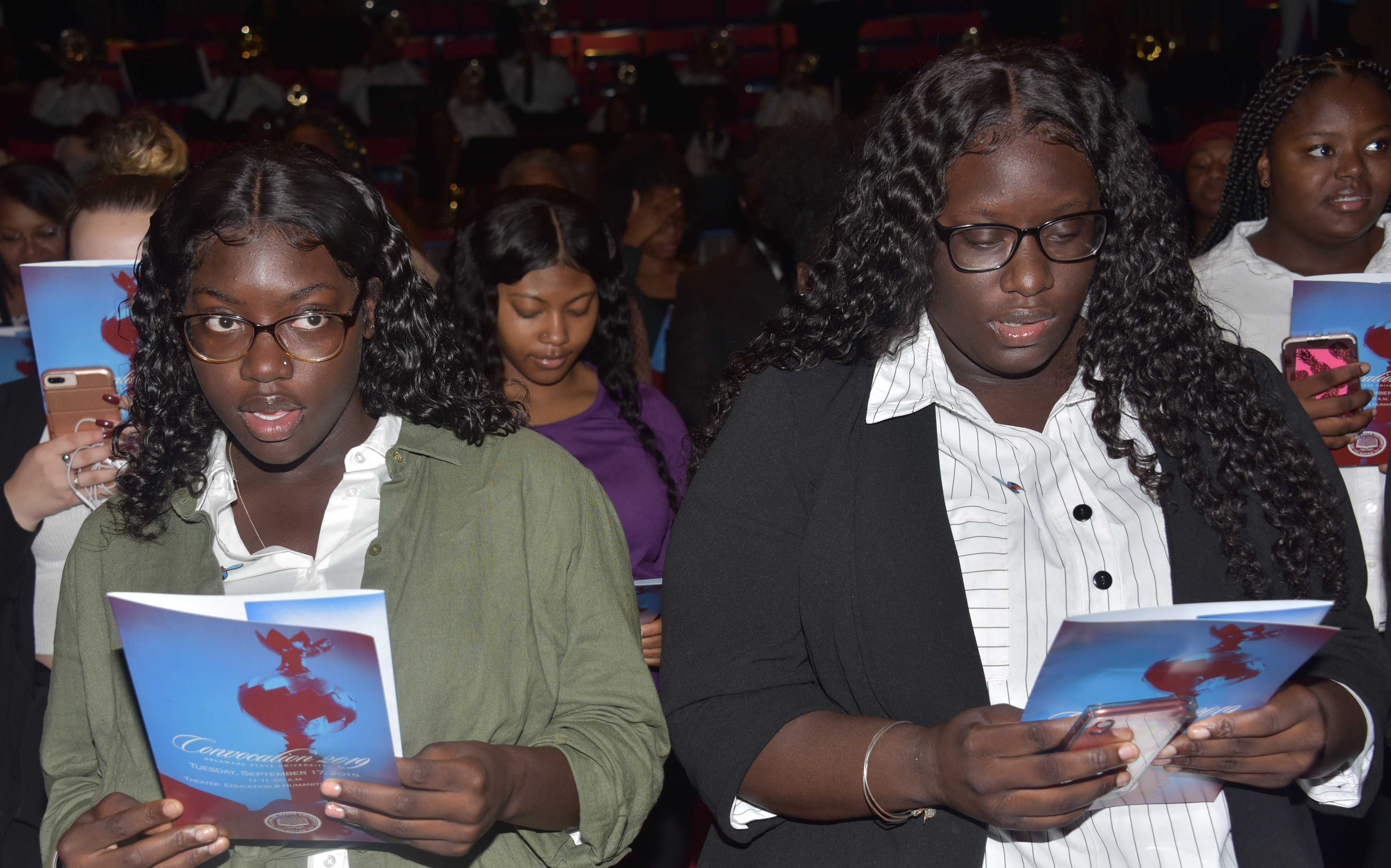Two freshmen sing the University's Alma Mater at the end of the Sept. 19 Convocation Ceremony