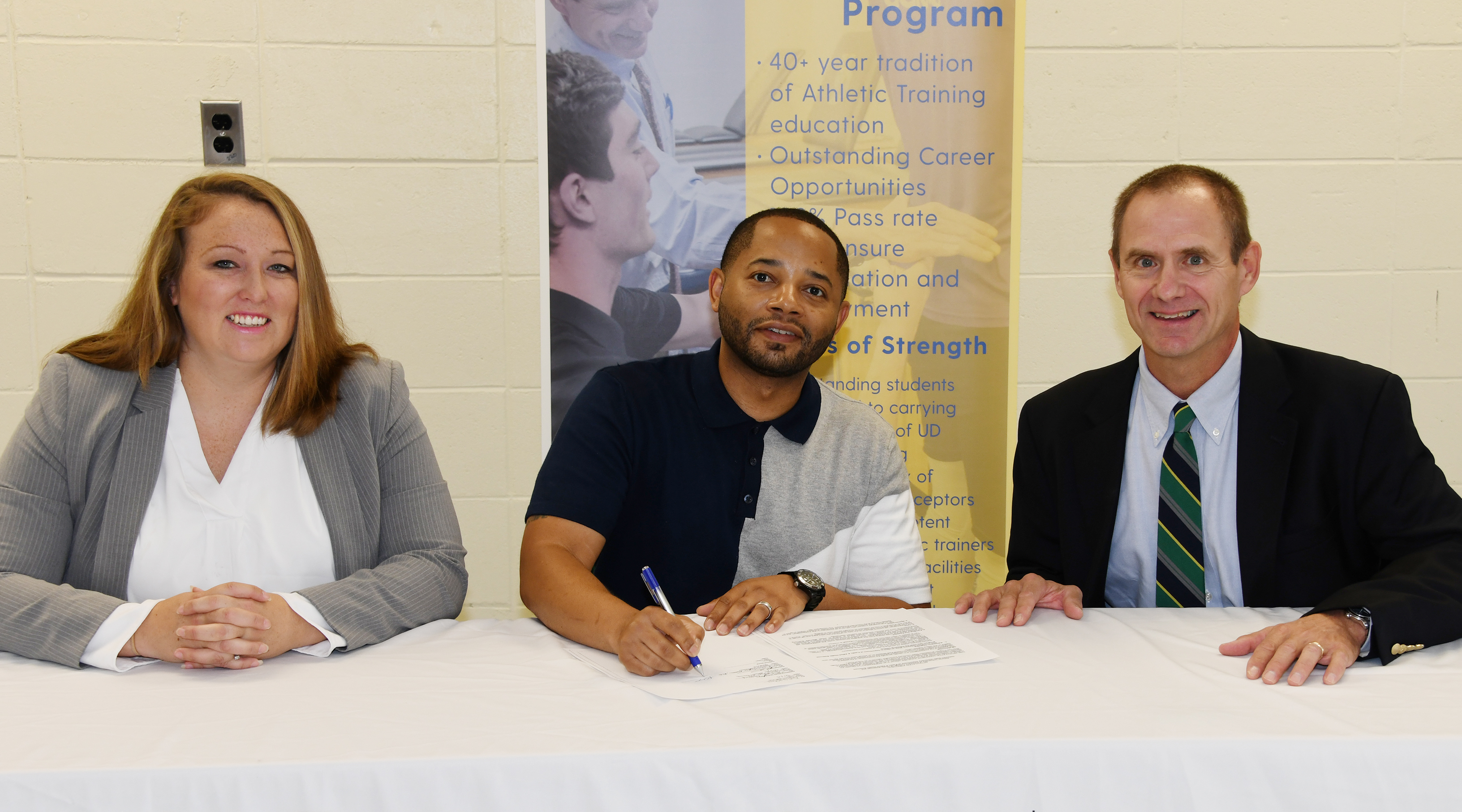 Delaware State University's Dr. Cara Gomez and Dr. R. Christopher Mason join UD's Dr. Thomas Kaminski in signing an agreement that will create a pipeline for kinesiology students to enroll in UD's Athletic Training Master's Degree Program.
