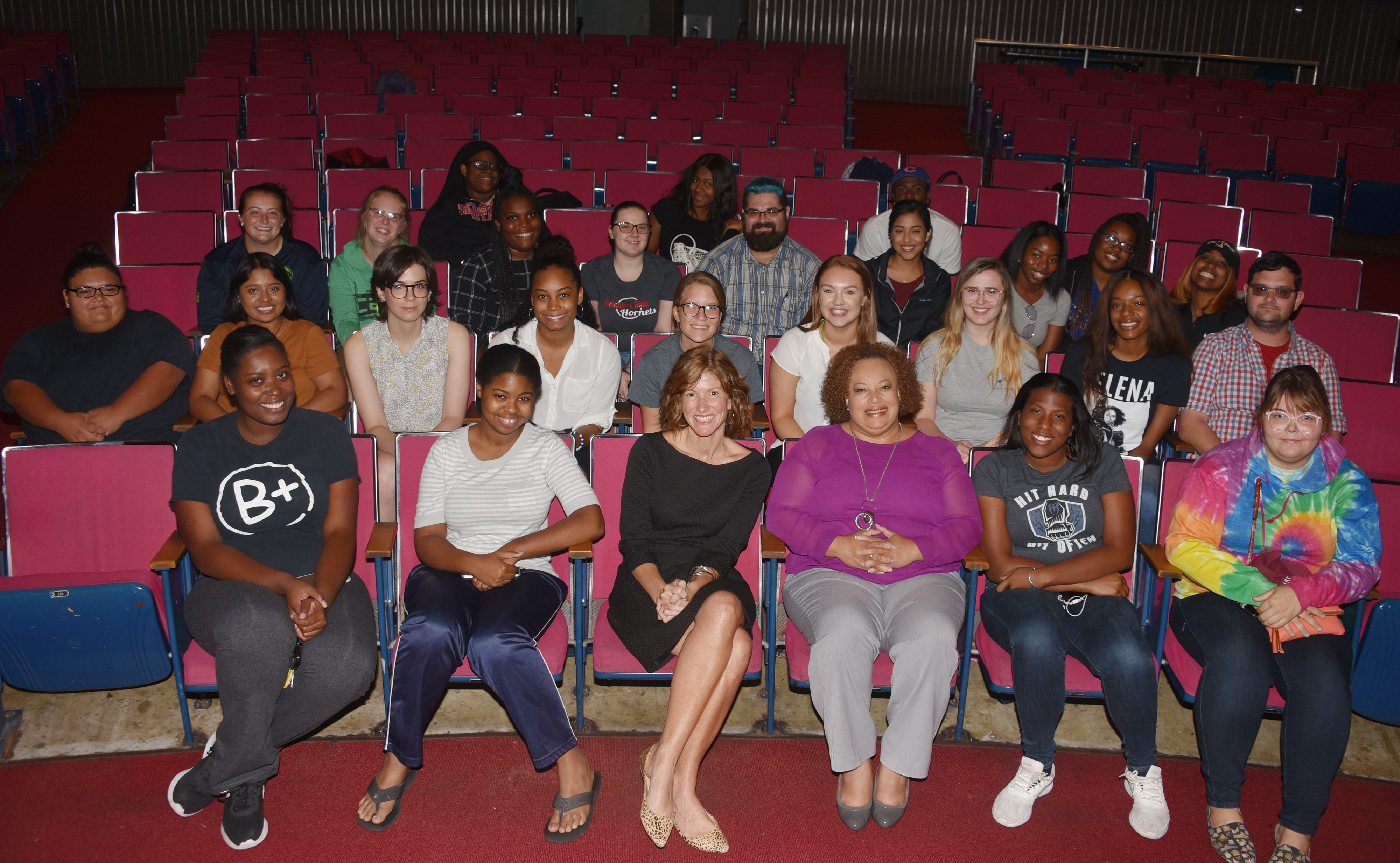 Dana Bowe (center front, black dress), 2019 Delaware Teacher of the Year, seated next to Dr. Crystal Timmons, director of Clinical and Field Experiences, poses with the education majors she shared her teaching experiences with on Sept. 25 in the Education and Humanities Theatre.