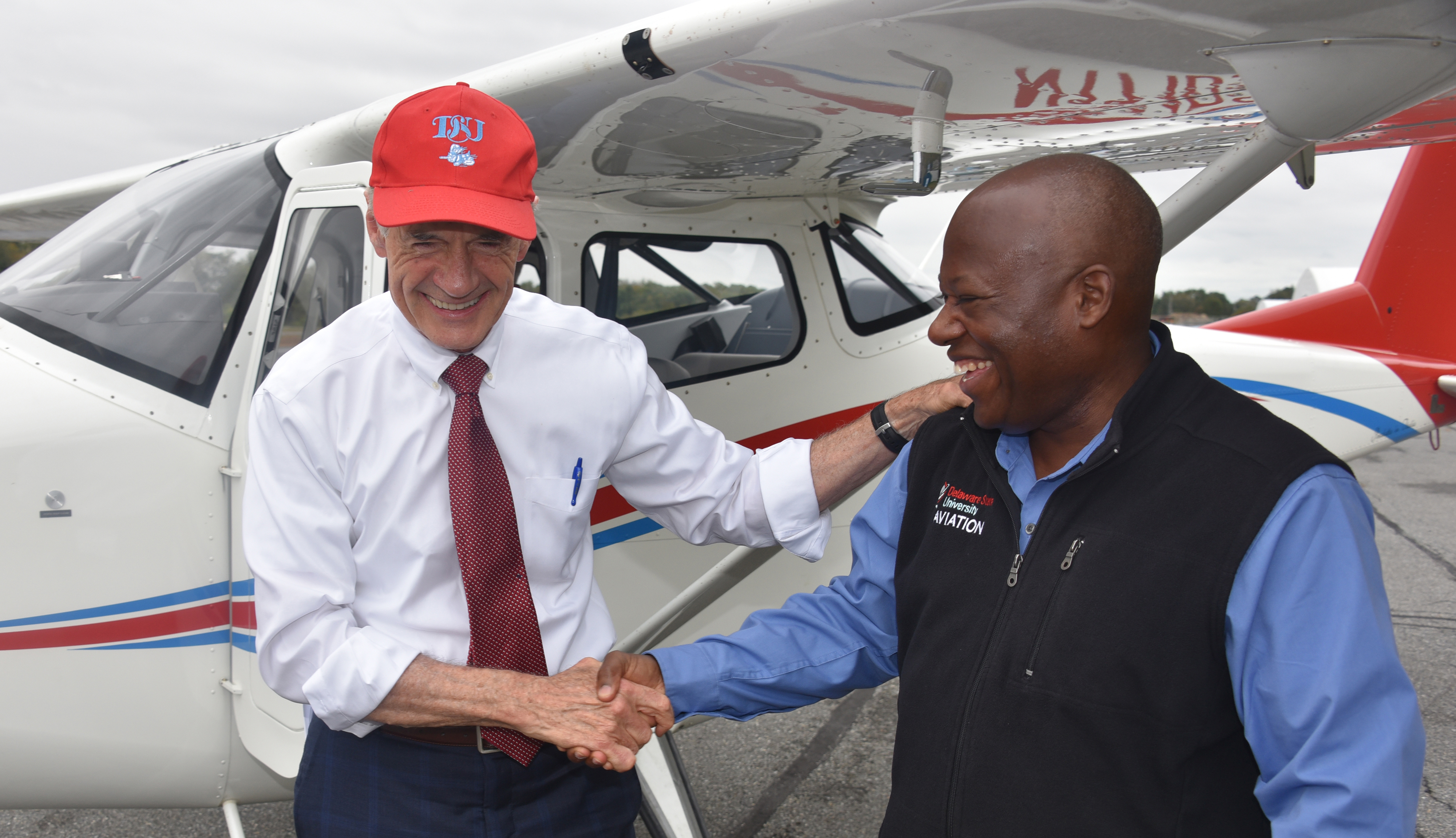 U.S. Sen. Tom Carper shakes hands with Lt. Col. Michael Hales, director of the University's Aviation Program, after the elected official flew one of the new planes recently acquired by Del State. Sen. Carper is a former naval aviator.