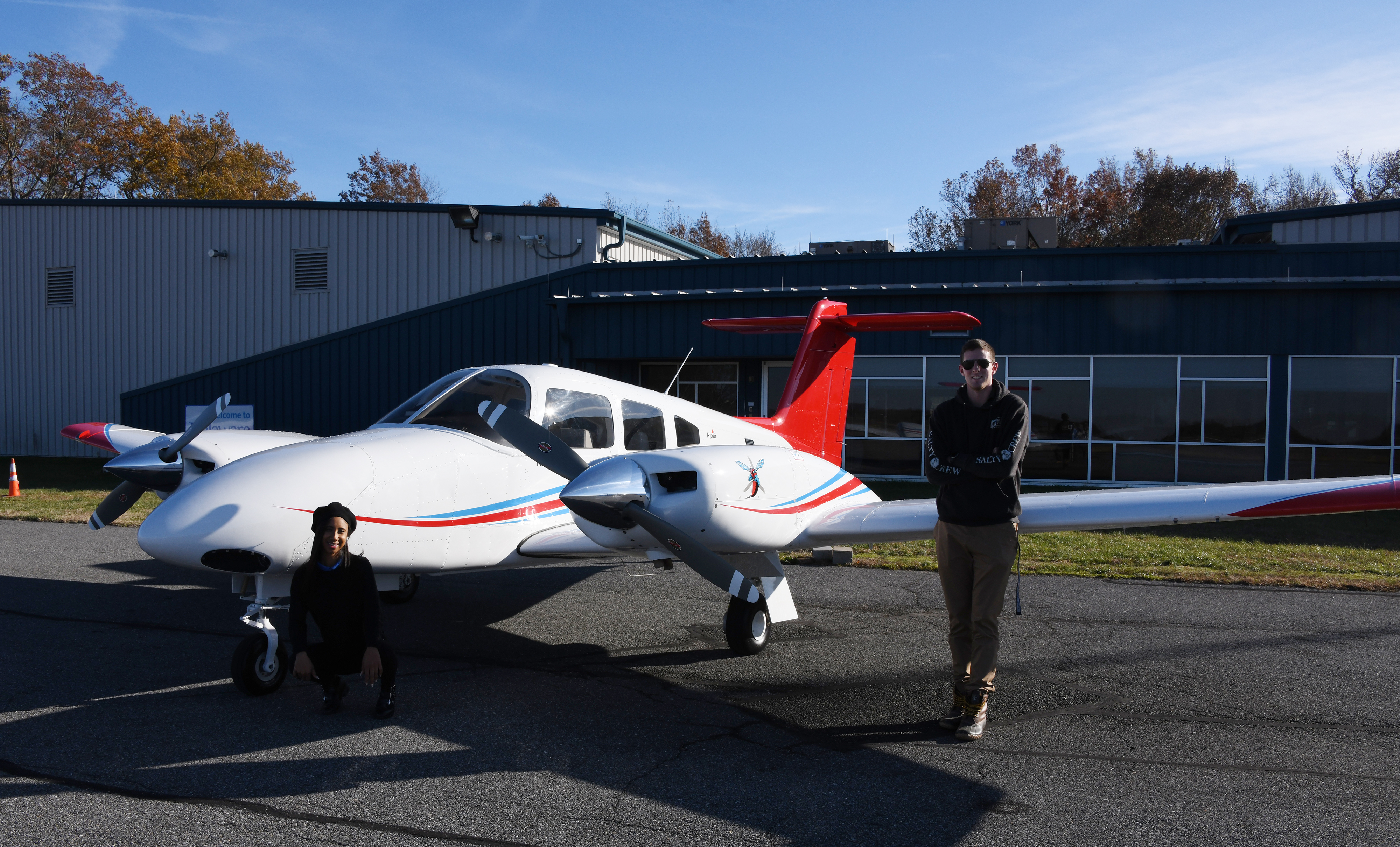 Zaneasia Perry, freshman aviation major, and Lane Deleon, flight instructor and Aviation Program alumnus, pose next to the new twin-engine Piper Seminole recently delivered to the Aviation Program at the Delaware Air Park.