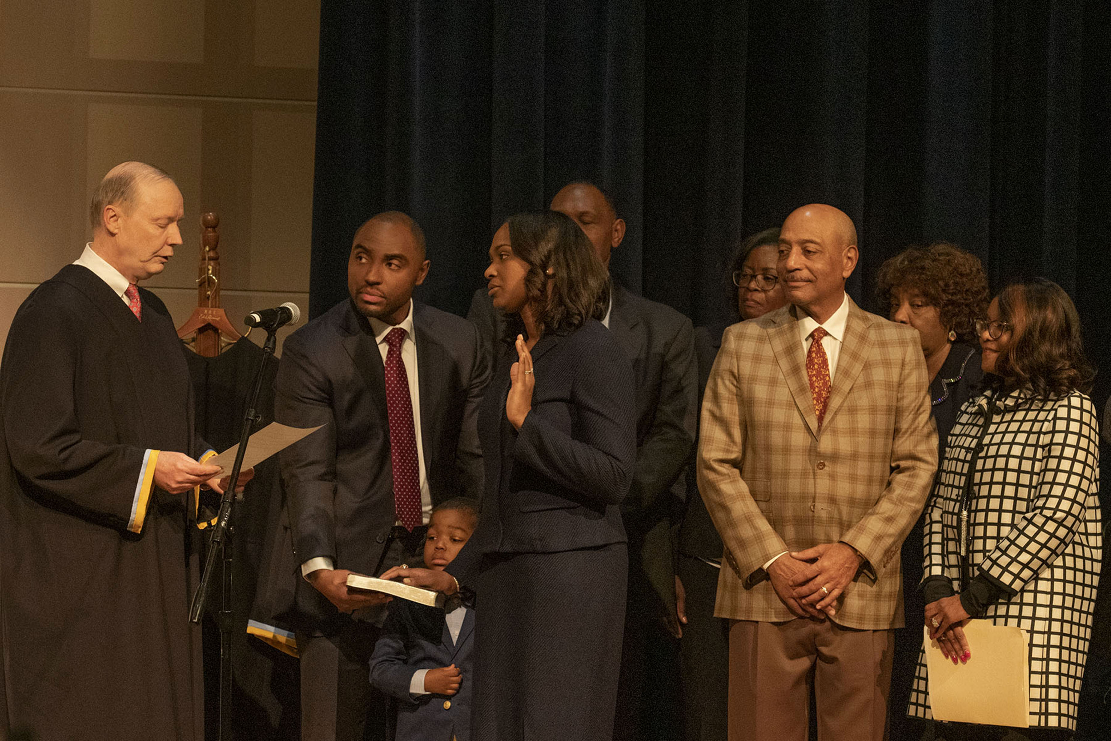 Tamika Montgomery-Reeves (with her hand raised) is sworn in by Delaware Supreme Court Chief Justice Colin Seitz, Jr. (l), as the first-ever African American to serve as an associate justice on the Delaware Supreme Court.