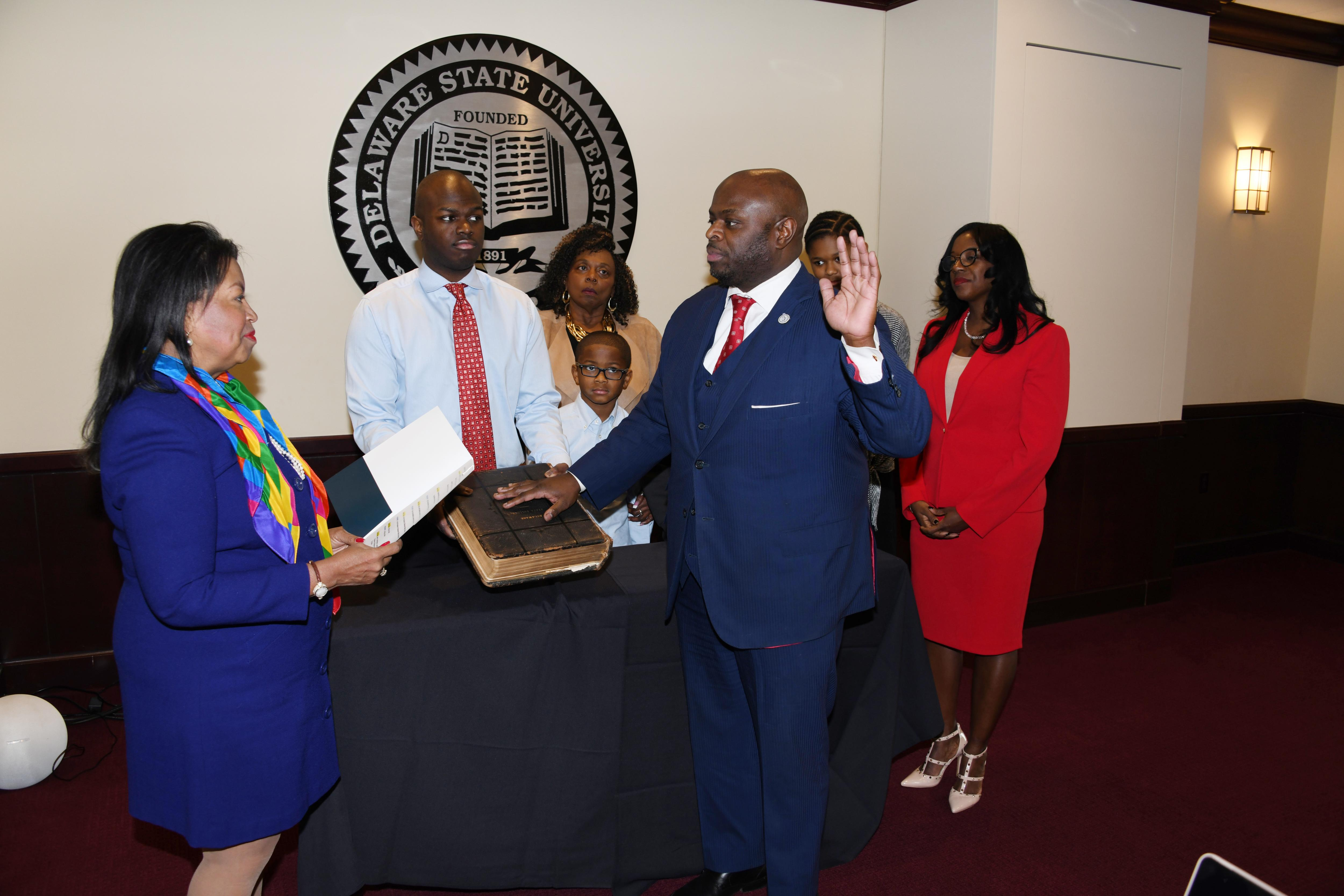 Board of Trustees Chairperson Devona Williams swears in Dr. Tony Allen as the 12th President of Delaware State University during the board Jan. 23 meeting.