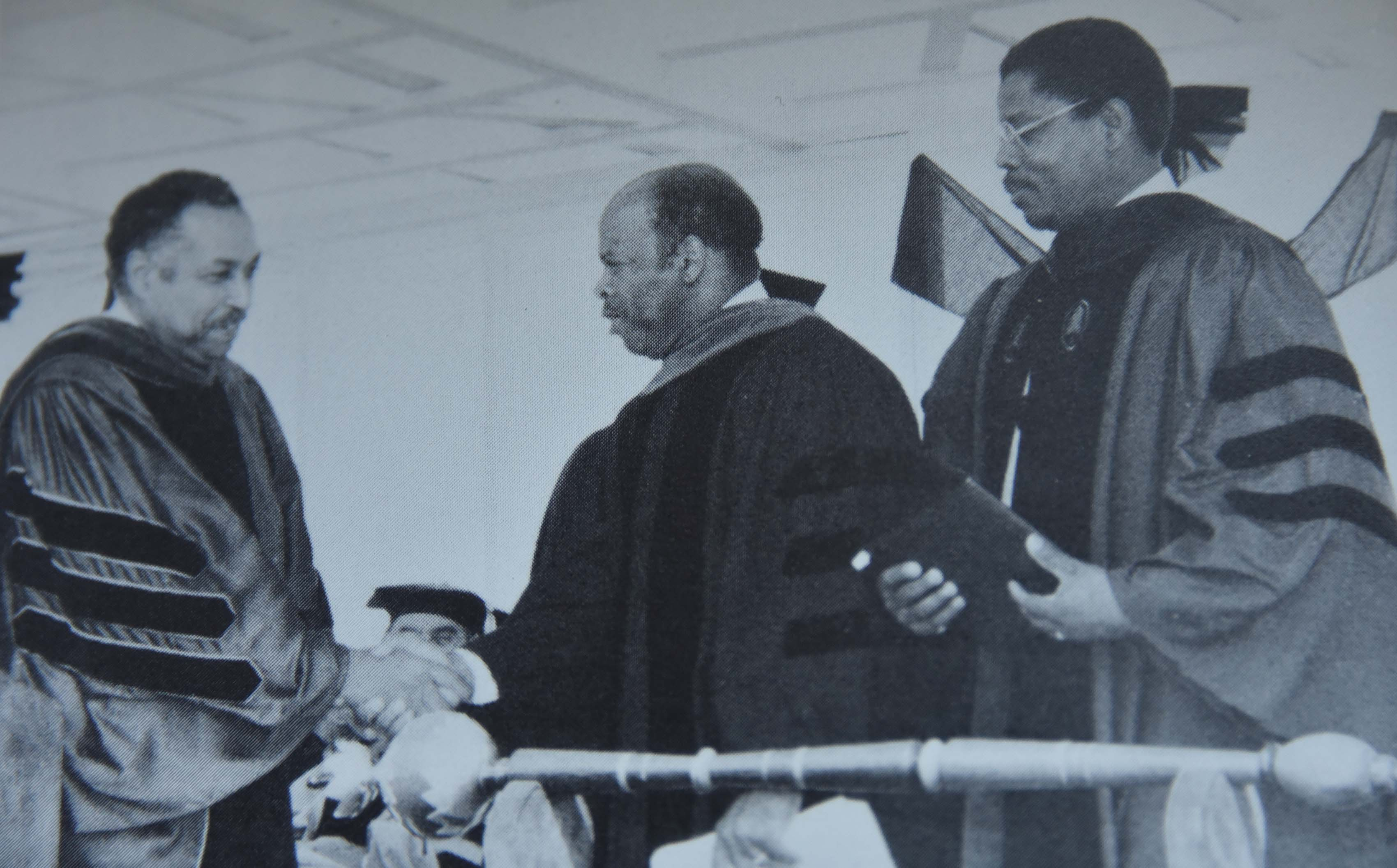 Congressman John R. Lewis -- shown shaking hands with Del State President William B. DeLauder with then-interim Vice President of Academic Affairs, Dr. Henry Tisdale looking on -- was the keynote speaker at Delaware State College's 1988 Commencement Ceremony.