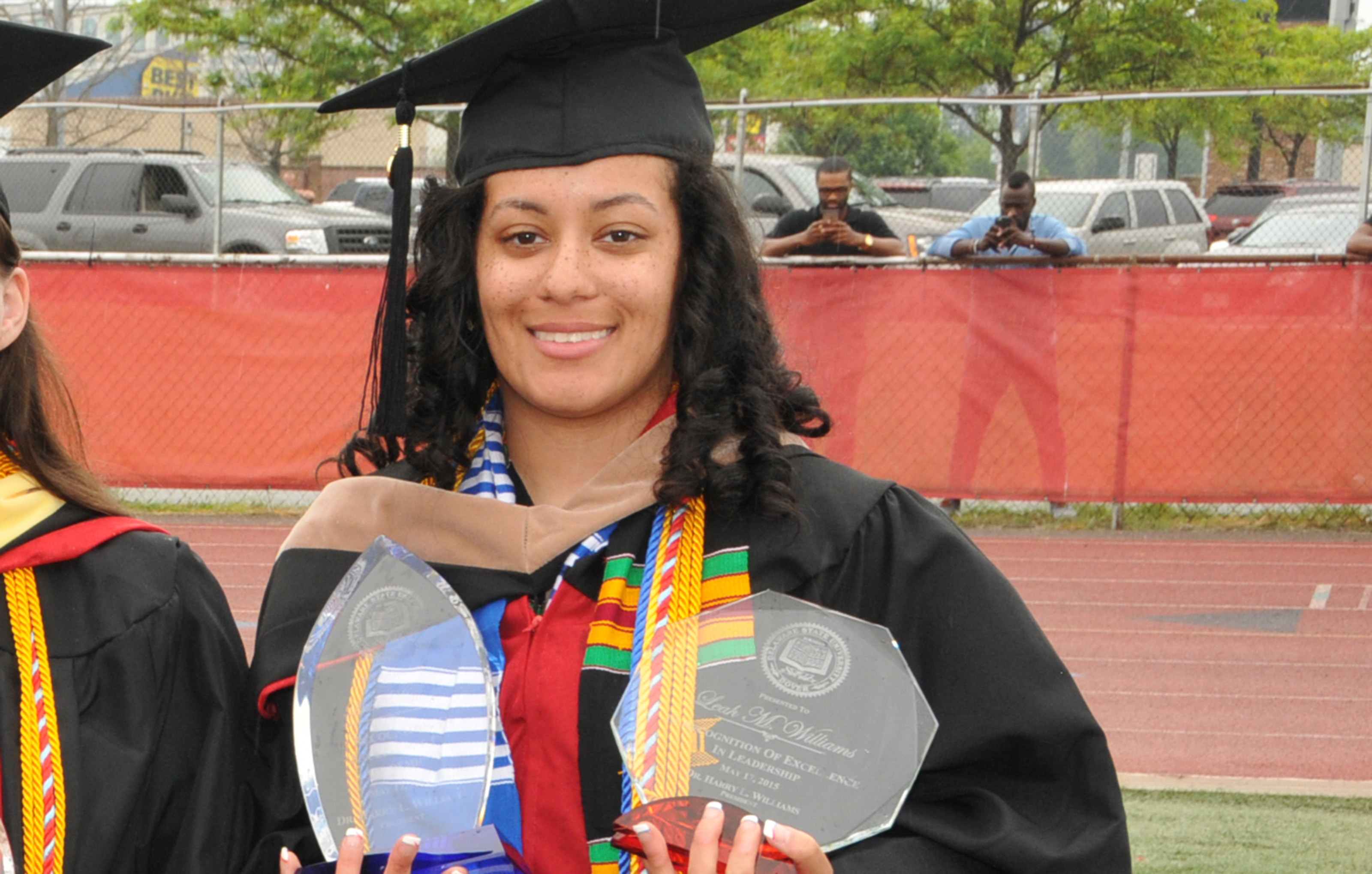 Leah Williams, 2020 Convocation keynote speaker, is shown in a 2015 graduation photo as she holds her University history-making Presidential Academic Award and Presidential Leadership Award -- the only Del State graduate to win both awards.