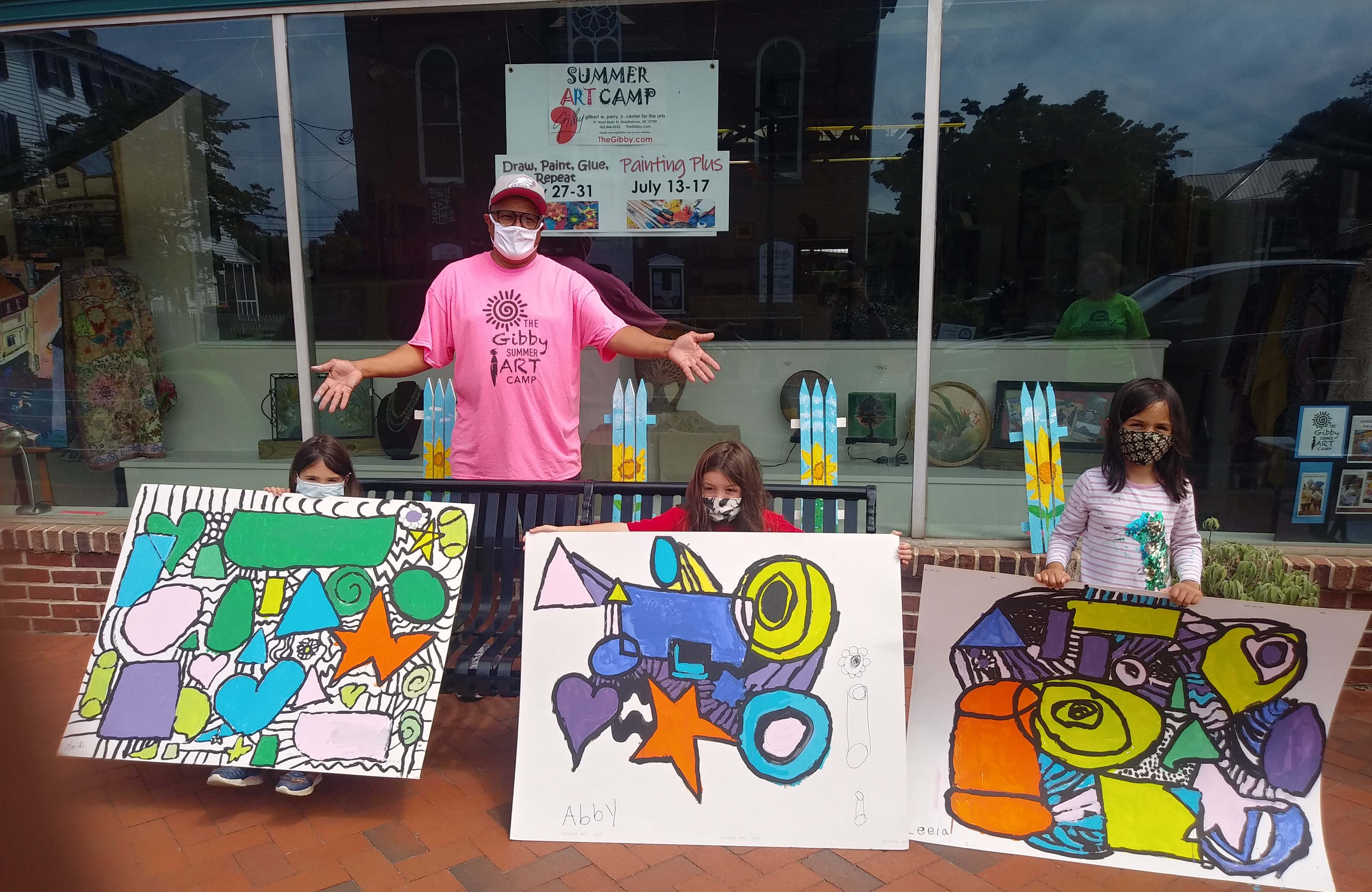 Milton Downing, 2021 Art Educator of the Year, stands with young summer camps participants and their painted creations at the Gibby Center for the Arts in Middletown.