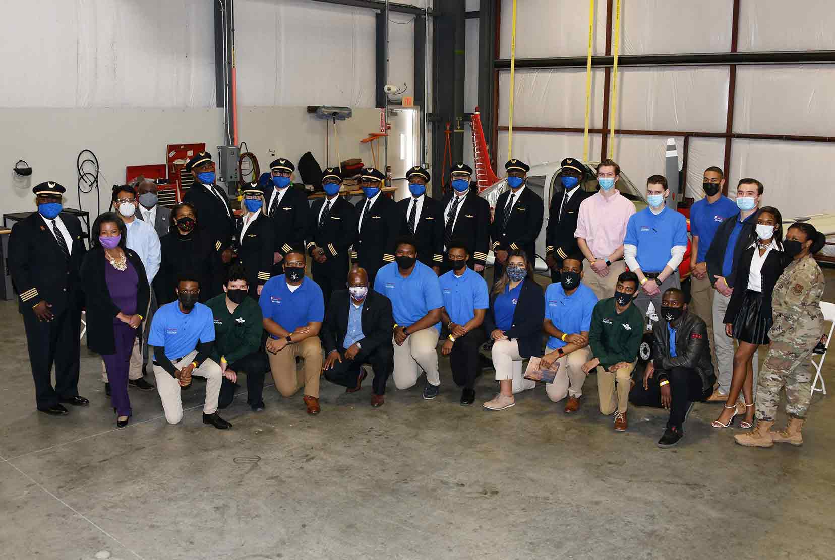 A group of Del State Aviation alumni (all United Airlines pilots), current Aviation students, and University officials come together for a group photo at the end of the April 15 celebration of Delaware State University partnership with United's Aviate Program.