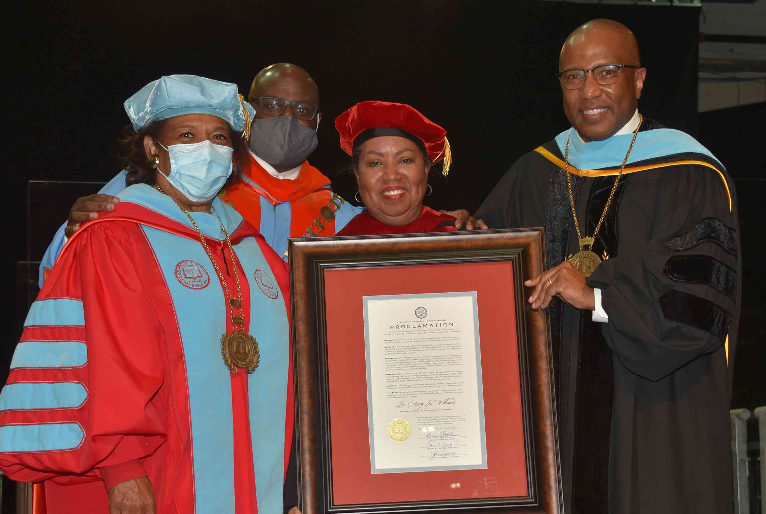 Dr. Harry L. Williams (r), the 10th president of Del State, was awarded President Emeritus status during the undergraduate Commencement ceremonies on May 8. Standing with him are Dr. Wilma Mishoe, Dr. Tony Allen and Board Chair Dr. Devona Williams.