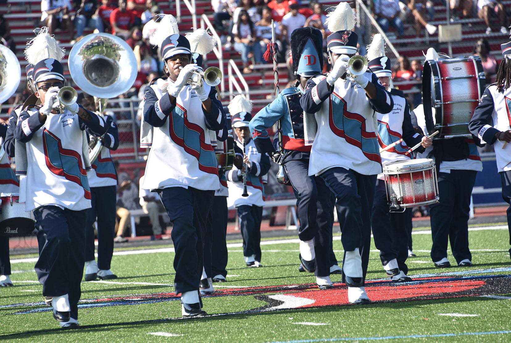 Former Approaching Storm members Sidney Sessoms and Vincent Adkins have been named as the new band director and assistant band director, respectively,  for Del States' premier marching band.